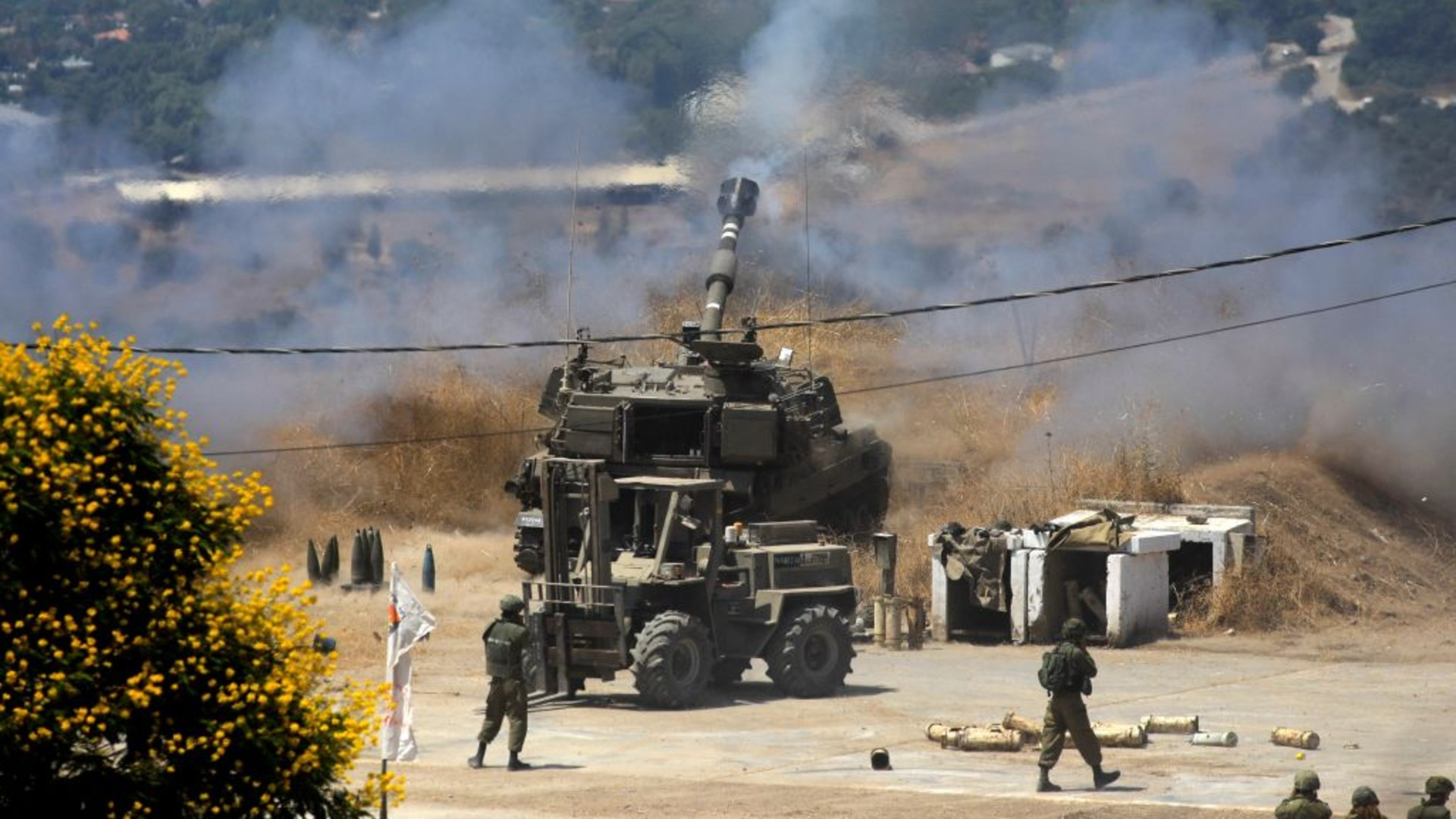 Israeli self-propelled howitzers fire towards Lebanon from the northern Israeli town of Kiryat Shmona following rocket fire from the Lebanese side of the border, on August 4, 2021. (JALAA MAREY/AFP via Getty Images)