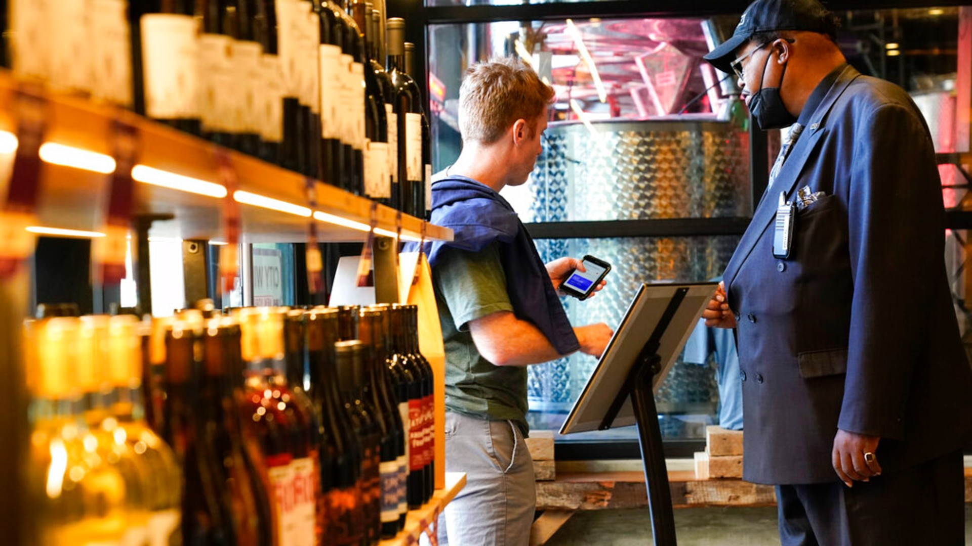 Security personnel ask customers for proof of vaccination as they enter City Winery Thursday, June 24, 2021, in New York. (AP Photo/Frank Franklin II)