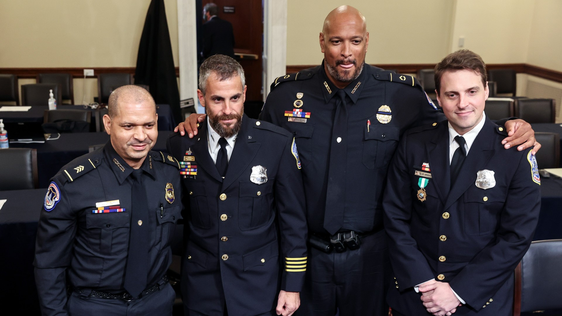 From left, U.S. Capitol Police Sgt. Aquilino Gonell, Washington Metropolitan Police Department officer Michael Fanone, U.S. Capitol Police Sgt. Harry Dunn and Washington Metropolitan Police Department officer Daniel Hodges pose for a photo after a House select committee hearing on the Jan. 6 attack on Capitol Hill in Washington, Tuesday, July 27, 2021. (Oliver Contreras/The New York Times via AP, Pool)