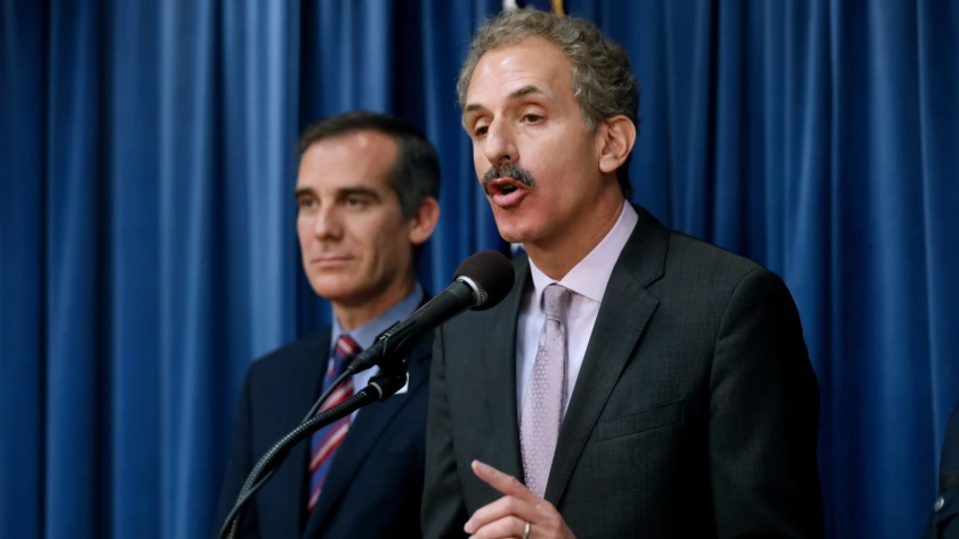 Los Angeles City Atty. Mike Feuer, standing alongside Mayor Eric Garcetti, is one of only two elected officials currently running for mayor in 2022.(Gary Coronado/Los Angeles Times)