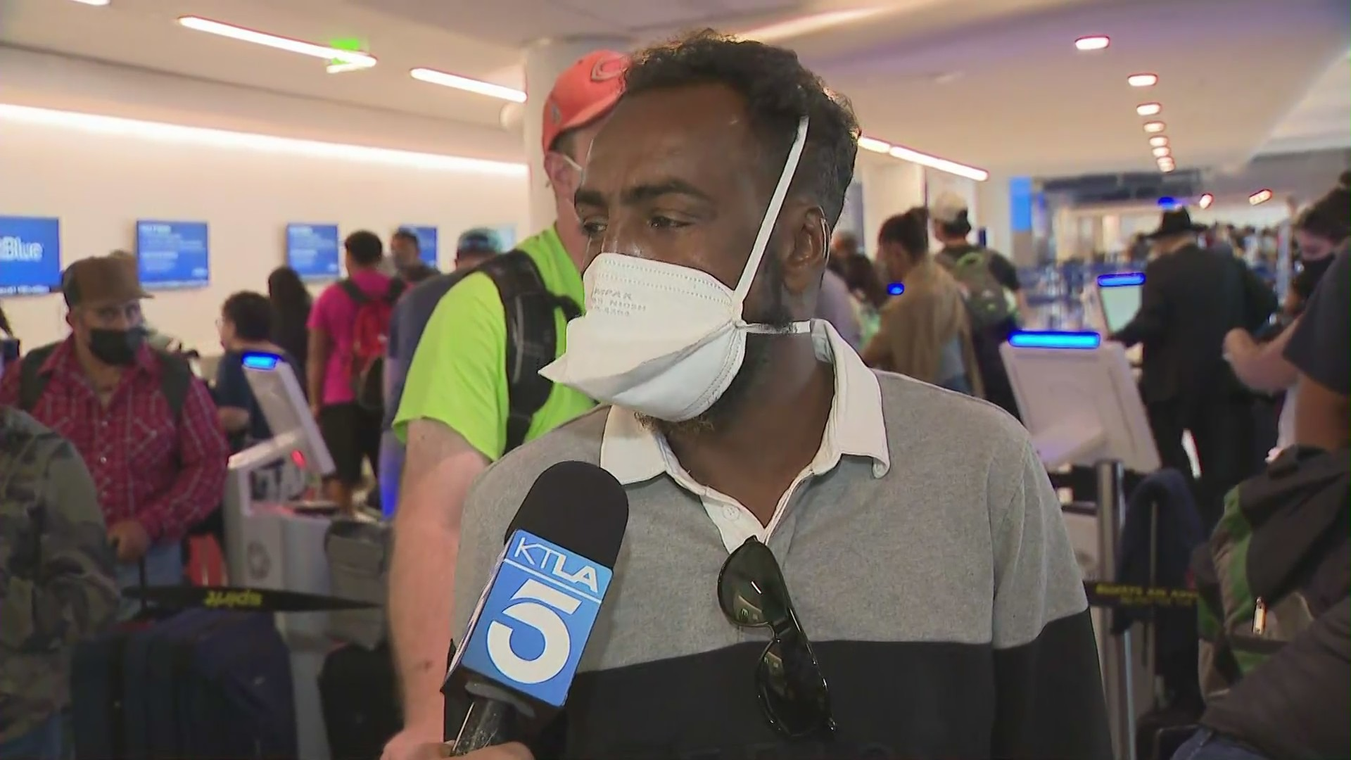 A man waiting to talk to a Spirit Airlines representative on Aug. 3, 2021, says he's been waiting two days for a flight out of LAX. (KTLA)