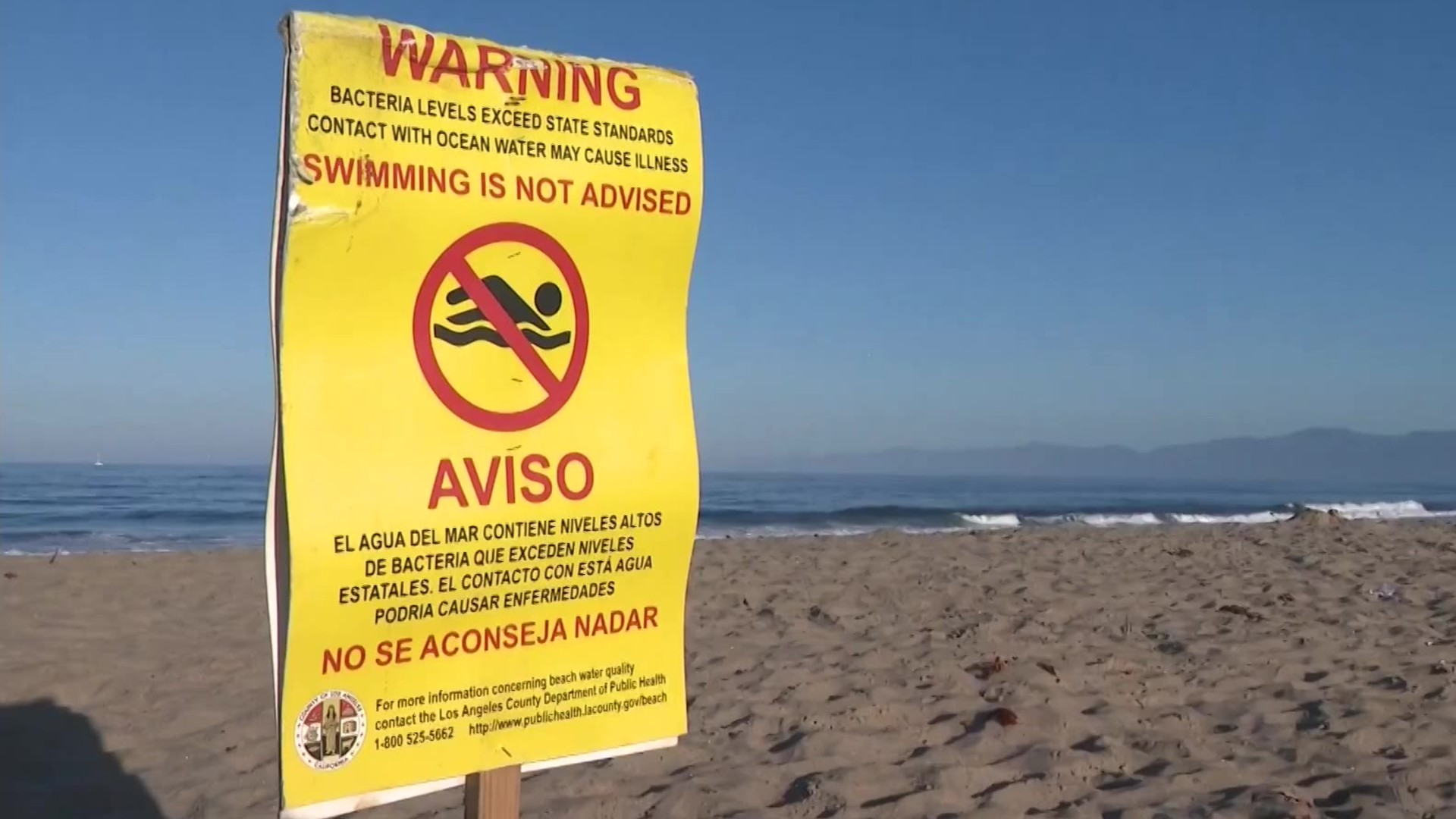 A sign warning swimmers about high bacteria levels is seen on a Southern California beach in this file image. (KTLA)