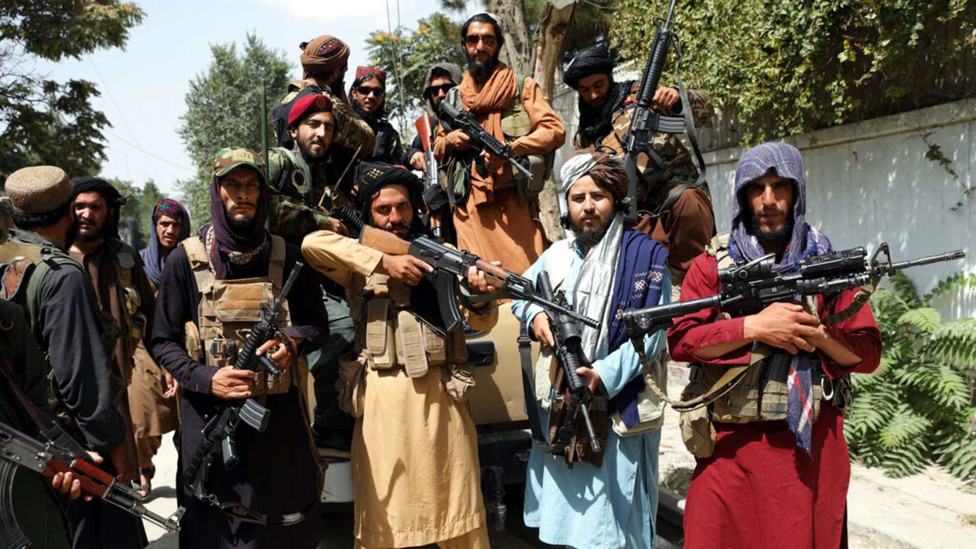 Taliban fighters pose for a photograph in Kabul, Afghanistan, Thursday, Aug. 19, 2021. (AP Photo/Rahmat Gul)