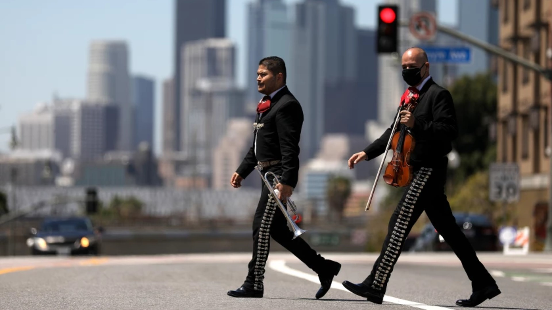 Mariachis cross 1st Street in Boyle Heights. In newly released U.S. census figures, the neighborhood recorded a decline in population, but downtown to the west saw a huge increase.(Gary Coronado / Los Angeles Times)