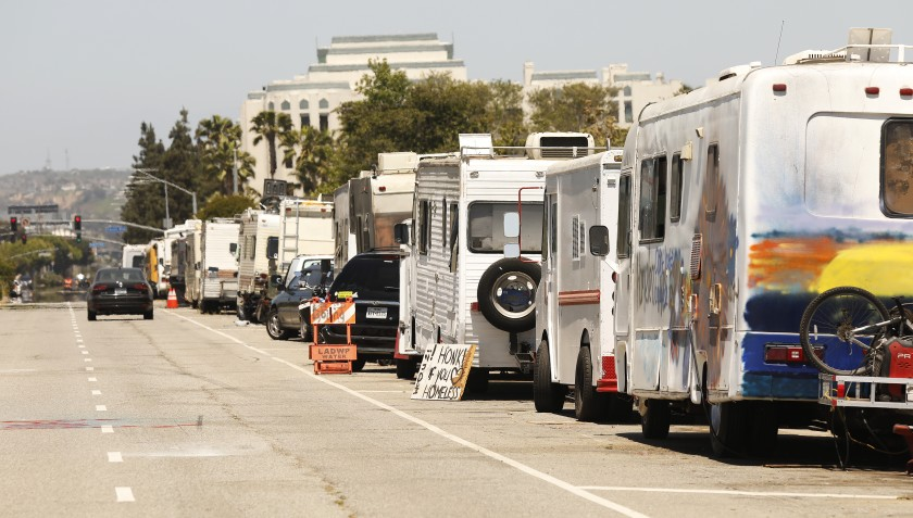 Campers are seen parked along West Jefferson Boulevard in Los Angeles in June 2021. (Al Seib / Los Angeles Times)