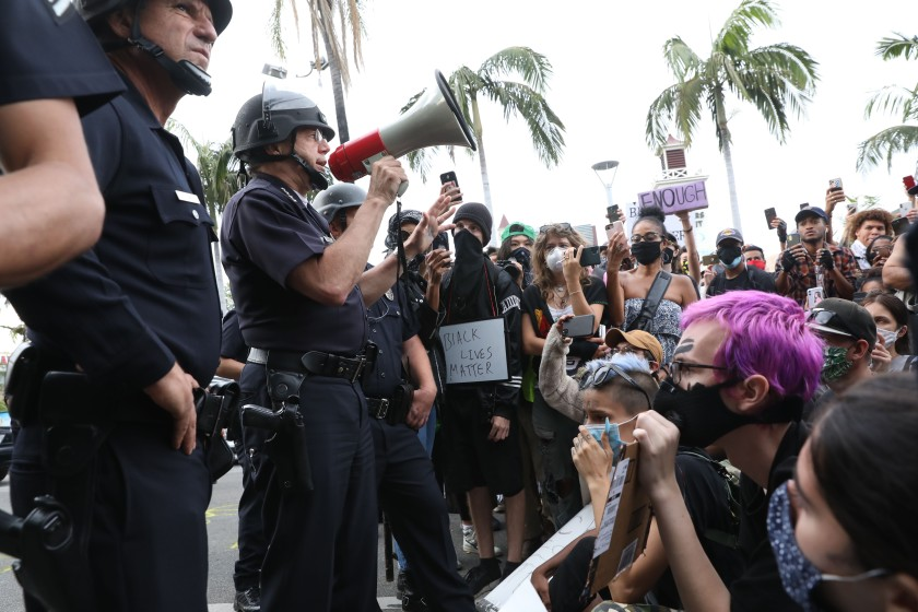 The LAPD responds to a mass demonstrations in the Fairfax district in May 2020, where Chief Michel Moore used a bullhorn to address the crowd. (Gary Coronado / Los Angeles Times)