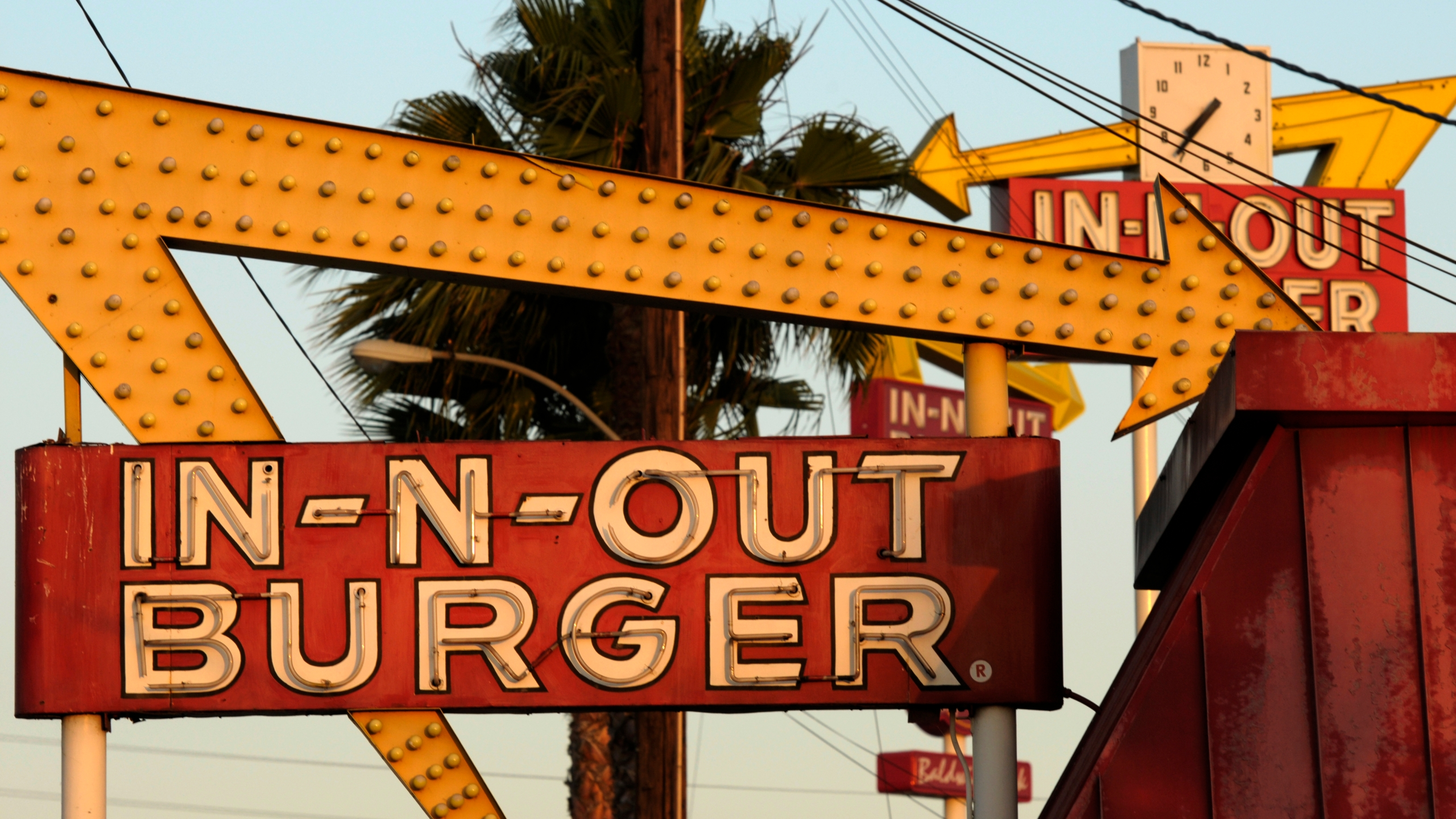 In this June 8, 2010, file photo, In-N-Out Burger signs fill the skyline in Baldwin Park. The restaurant's San Francisco was the location temporarily shut down. (AP Photo/Adam Lau, File)