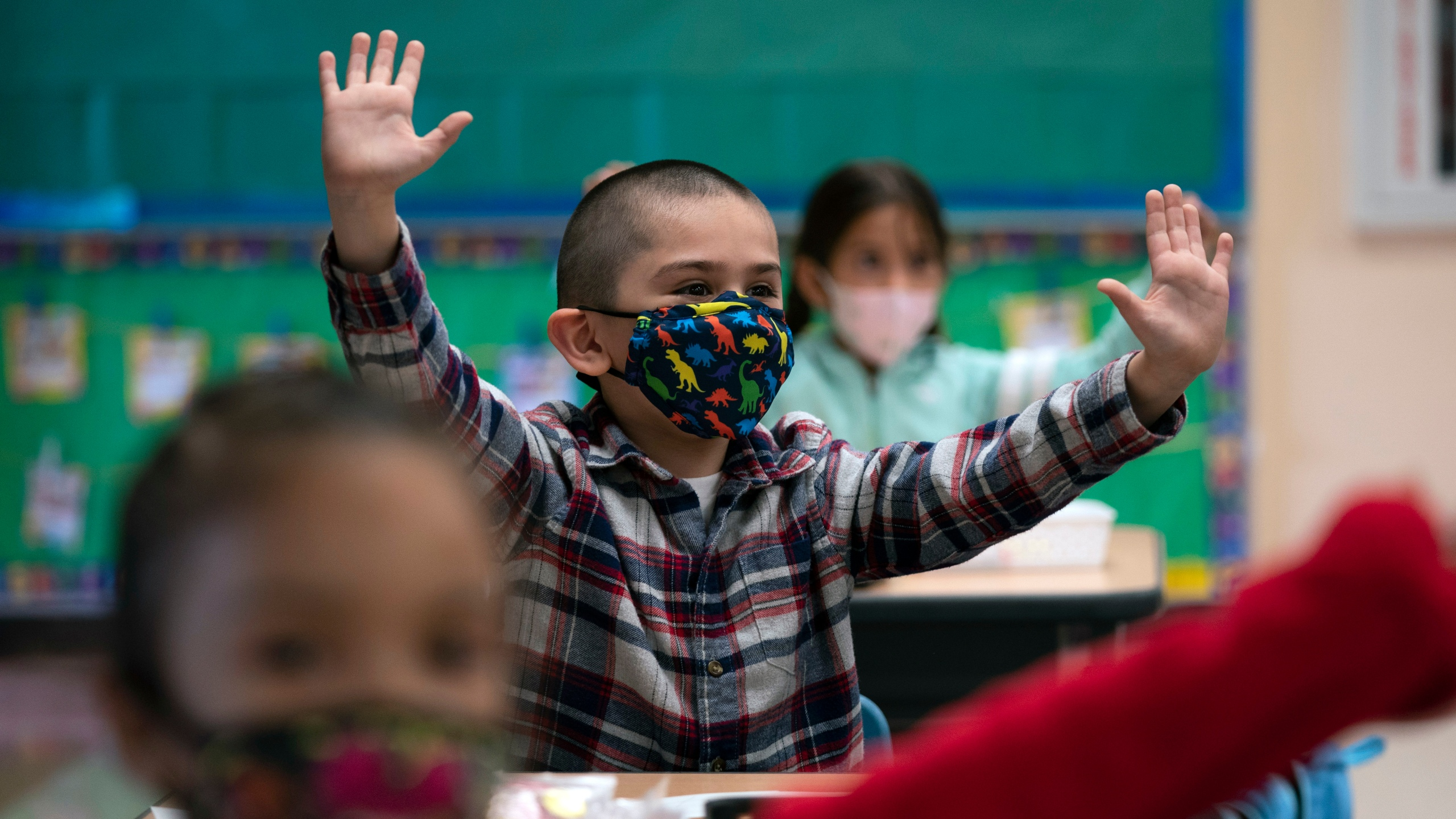 In this April 13, 2021, file photo, kindergarten students participate in a classroom activity on the first day of in-person learning at Maurice Sendak Elementary School in Los Angeles. (AP Photo/Jae C. Hong, File)