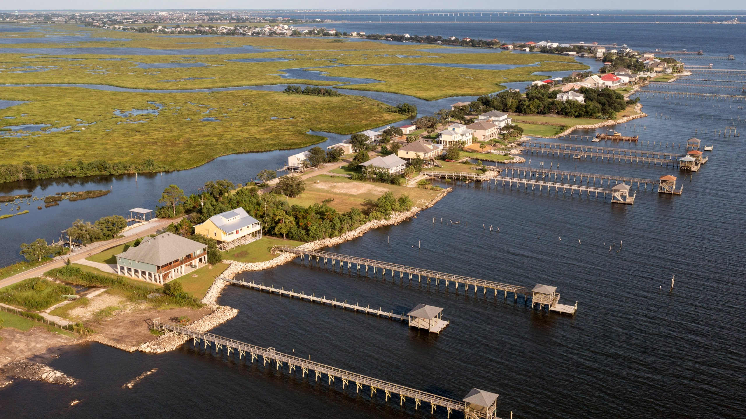 Few signs of activity are seen along the shoreline of Lake Pontchartrain as residents prepare for the expected arrival of Hurricane Ida Saturday, Aug. 28, 2021, in Slidell, La. The area was hard hit by Hurricane Katrina and it appears that most residents have evacuated prior to the arrival of Hurricane Ida. (AP Photo/Steve Helber)
