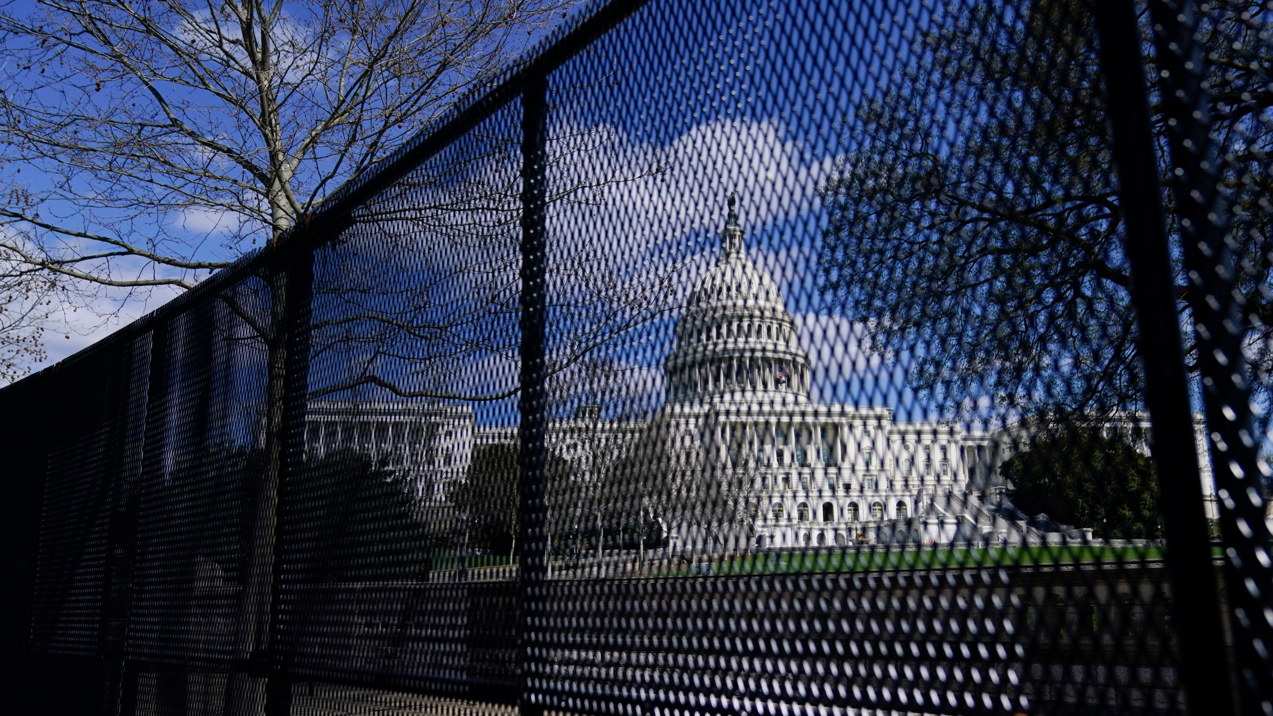 In this April 2, 2021, file photo, the U.S. Capitol is seen behind security fencing on Capitol Hill in Washington. Law enforcement concerned by the prospect for violence at a rally in the nation's Capitol next week are planning to reinstall protective fencing that surrounded the U.S. Capitol for months after the Jan. 6 insurrection there, according to a person familiar with the discussions. (AP Photo/Carolyn Kaster, File)
