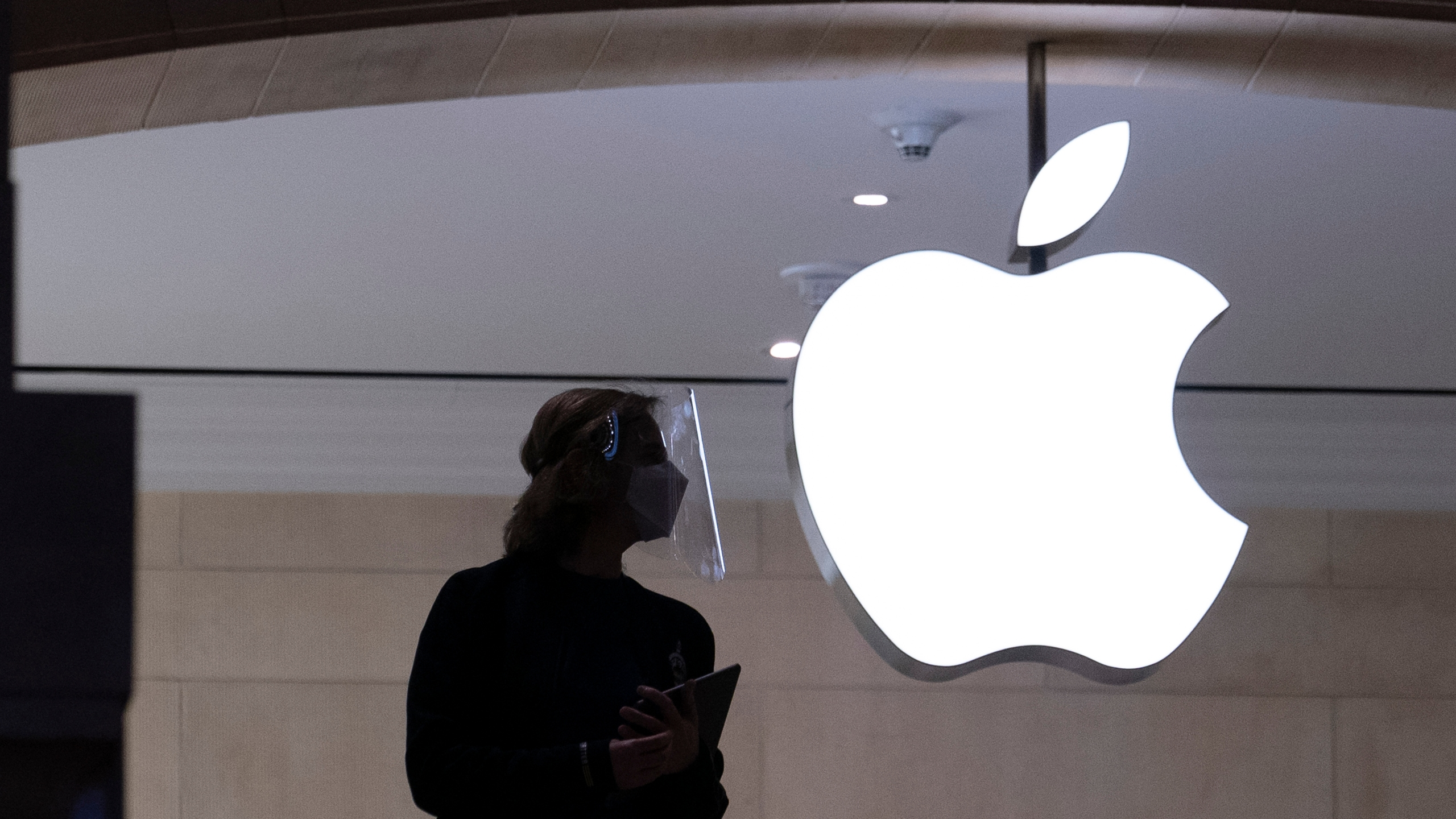 In this Feb. 5, 2021 photo, an Apple store employee is shown in New York. (Mark Lennihan/Associated Press)