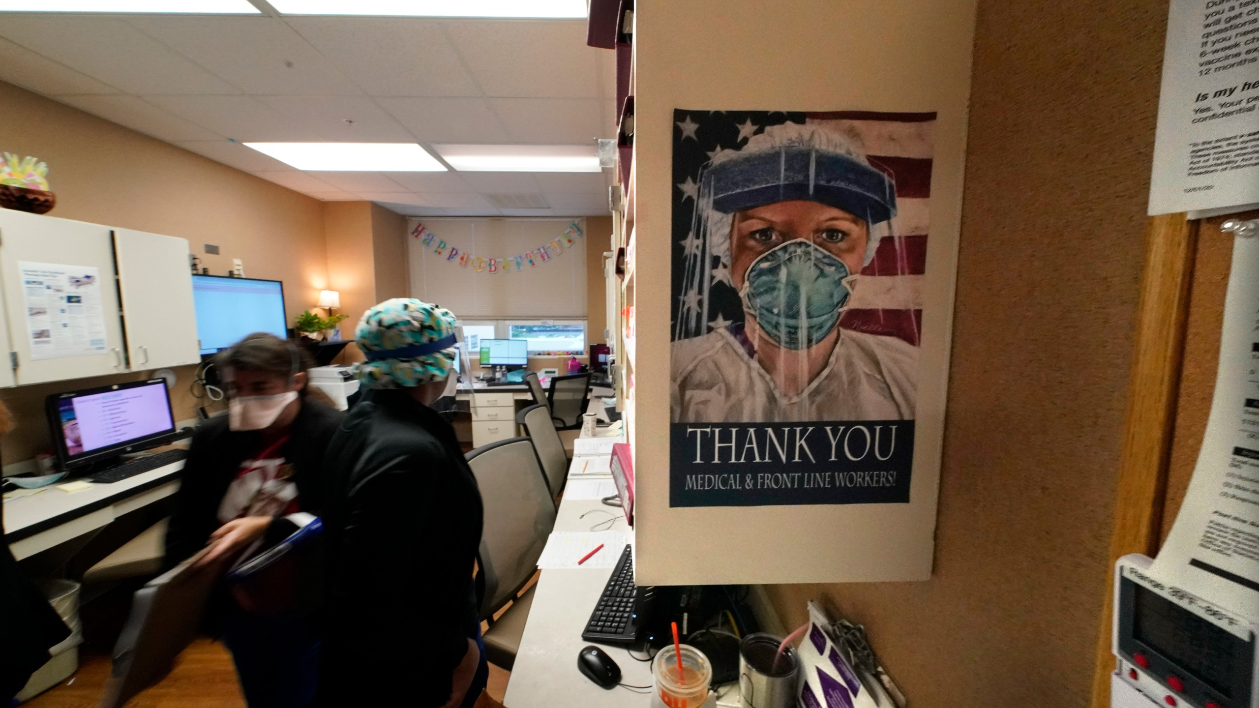 In this Aug. 18, 2021, file photo, a poster honoring medical and frontline workers, hangs on a nursing station of an intensive care unit, at the Willis-Knighton Medical Center in Shreveport, La. (AP Photo/Gerald Herbert, File)