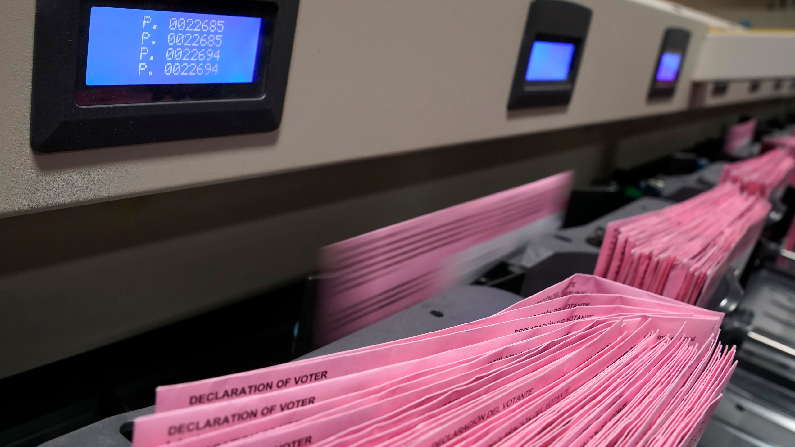 In this Aug. 30, 2021, file photo mail in ballots run through a sorting machine at the Sacramento County Registrar of Voters office in Sacramento, Calif. (AP Photo/Rich Pedroncelli, File)