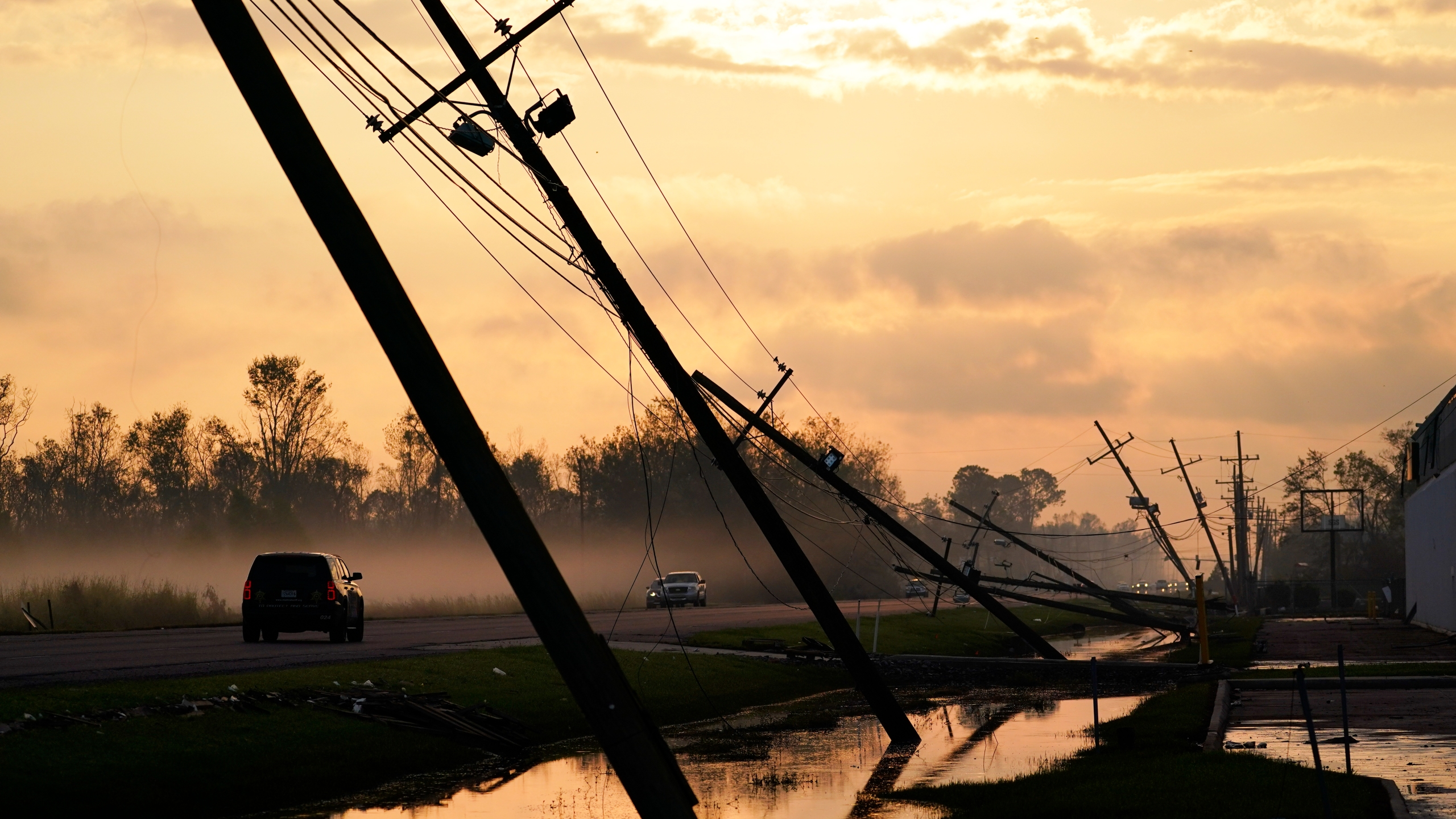 Downed power lines slump over a road in the aftermath of Hurricane Ida Sept. 3, 2021, in Reserve, Louisiana. (Matt Slocum/Associated Press)
