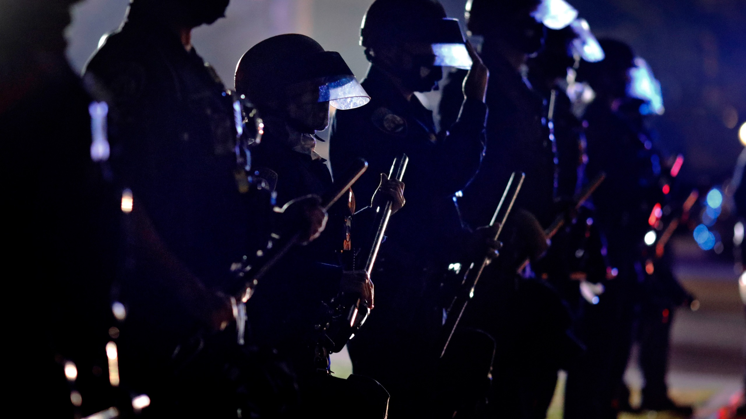 In this Tuesday, Nov. 3, 2020, file photo, police hold their clubs as they form a line in front of supporters of President Donald Trump on Election Day in Beverly Hills, Calif. (AP Photo/Ringo H.W. Chiu, File)