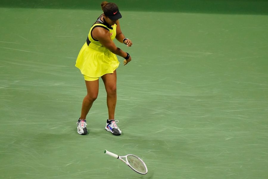 Naomi Osaka, of Japan, throws her racket down during a match against Leylah Fernandez, of Canada, at the third round of the US Open tennis championships, on Sept. 3, 2021, in New York. (Frank Franklin II/Associated Press)