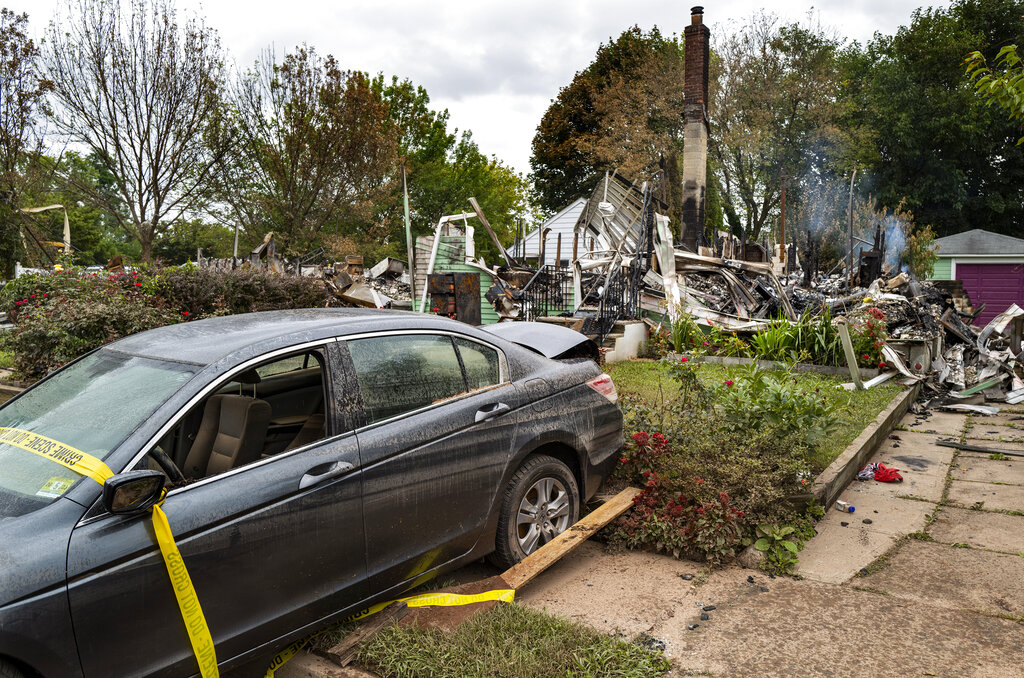 The remains of a home that burned still smolders in Manville, N.J., Sunday, Sept. 5, 2021, in the wake of the remnants of Hurricane Ida. (AP Photo/Craig Ruttle)
