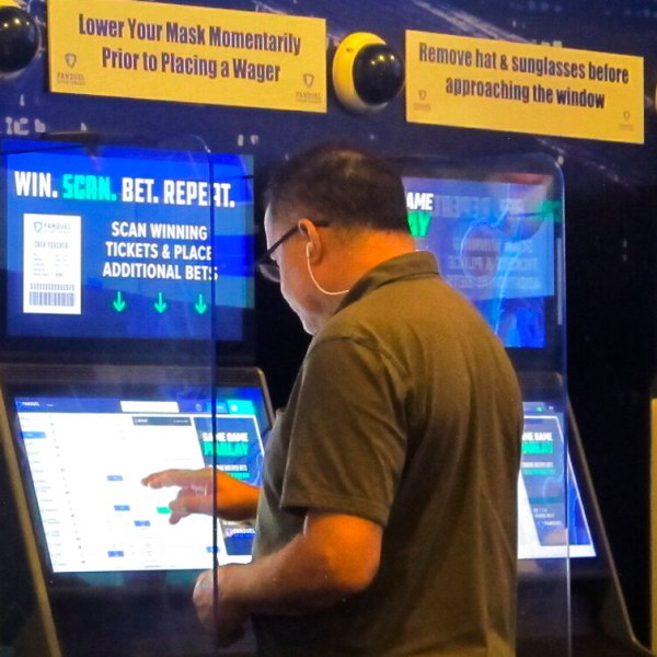 A gambler places a bet at the FanDuel sportsbook in East Rutherford N.J. on Aug. 30, 2021. (AP Photo/Wayne Parry)