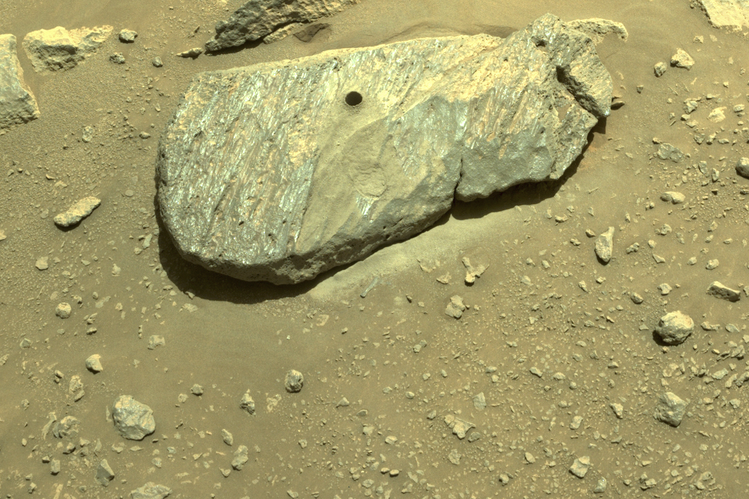 This Sept. 1, 2021 image provided by NASA shows the hole drilled by the Perseverance rover during its second sample-collection attempt in Mars' Jezero Crater. (NASA/JPL-Caltech via Associated Press)