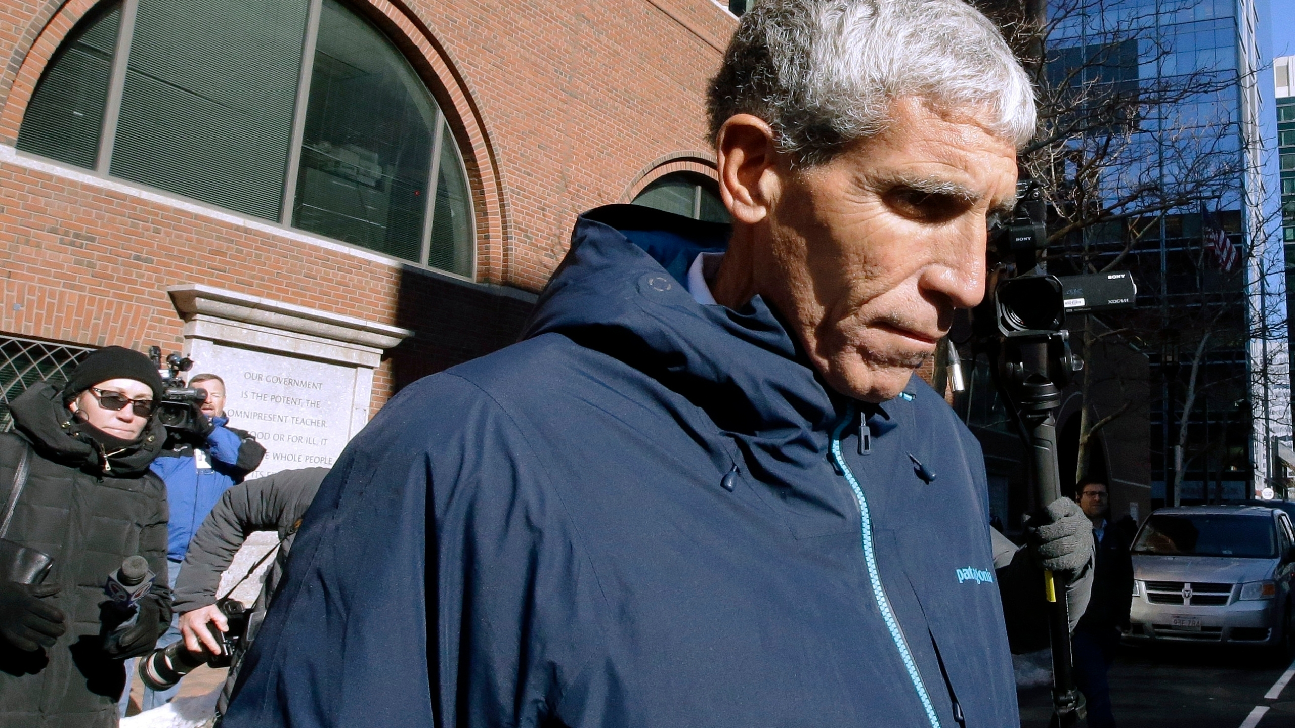 """In this March 12, 2019 file photo, William """"Rick"""" Singer founder of the Edge College & Career Network, departs federal court in Boston, after he pleaded guilty to charges in a nationwide college admissions bribery scandal. The first trial in the """"Operation Varsity Blues"""" college admissions bribery scandal will begin this week, Wednesday, Sept. 8, 2021 with the potential to shed light on investigators' tactics and brighten the spotlight on a secretive school selection process many have long complained is rigged to favor the rich. (AP Photo/Steven Senne, File)"""