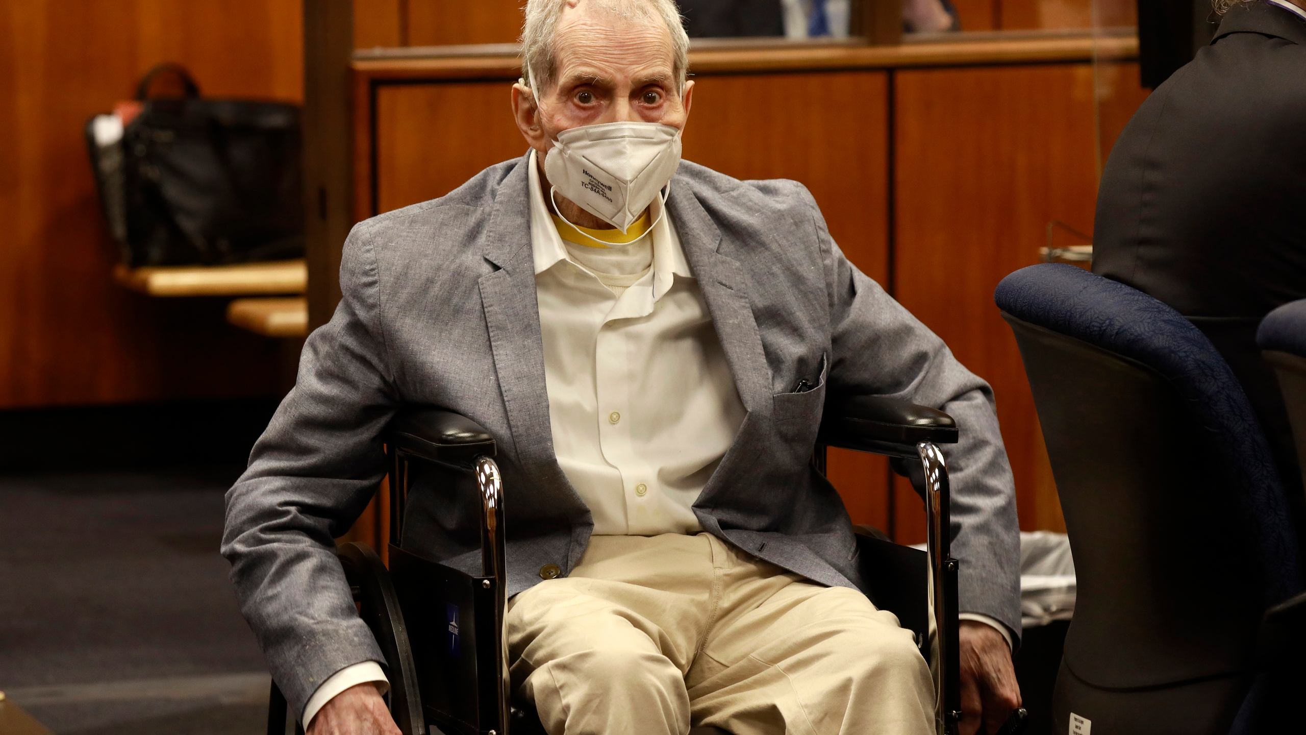 Robert Durst in his wheelchair spins in place as he looks at people in the courtroom in Inglewood, Calif. on Sept. 8, 2021, with his attorneys for closing arguments presented by the prosecution. (Al Seib/Los Angeles Times via AP, Pool)