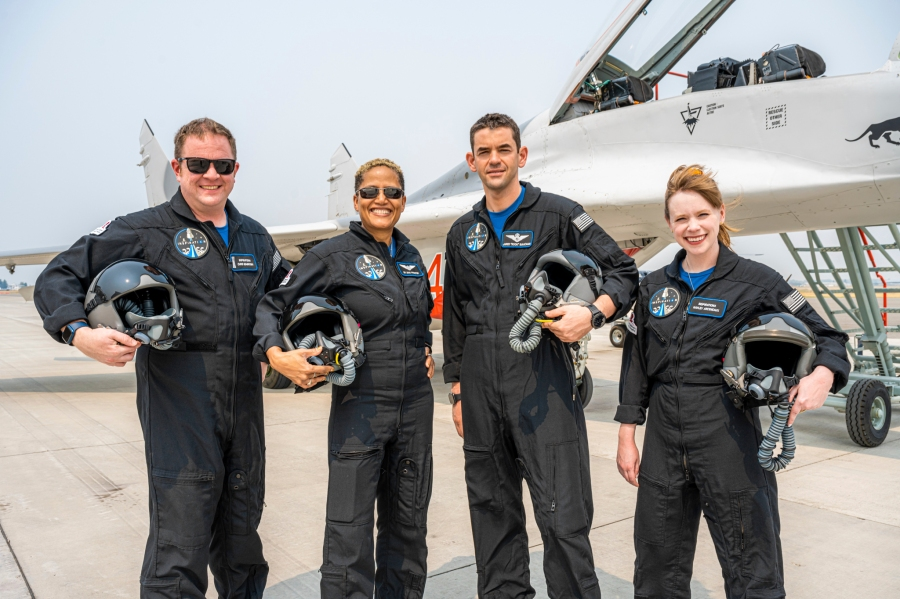 """In this Aug. 8, 2021, photo provided by John Kraus, from left, Chris Sembroski, Sian Proctor, Jared Isaacman and Hayley Arceneaux stand for a photo in Bozeman, Mont., during a """"fighter jet training"""" weekend to familiarize the crew with G-forces. (John Kraus/Inspiration4 via Associated Press)"""