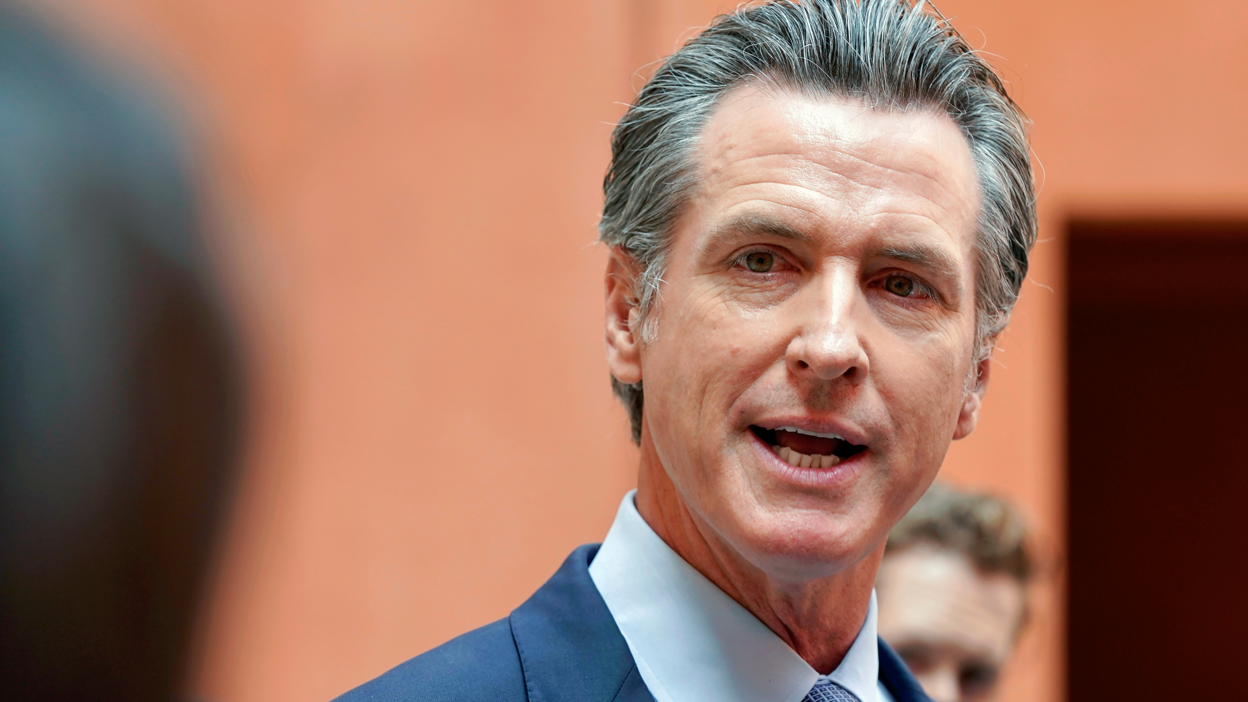 """In this Sept. 10, 2021, file photo California Gov. Gavin Newsom responds to a question while meeting with reporters after casting his recall ballot at a voting center in Sacramento, Calif. The last day to vote in the recall election is Tuesday Sept. 14. A majority of voters must mark """"no"""" on the recall to keep Newsom in office. (AP Photo/Rich Pedroncelli, File)"""