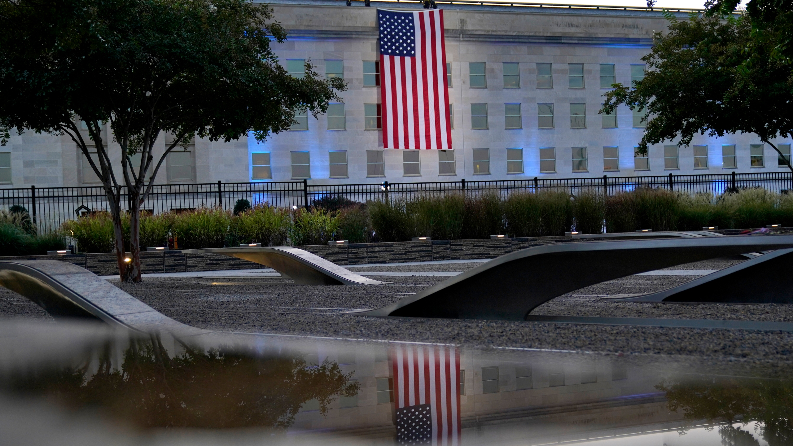 An American flag is unfurled at the Pentagon in Washington, Saturday, Sept. 11, 2021, at sunrise on the morning of the 20th anniversary of the terrorist attacks. (AP Photo/Alex Brandon)