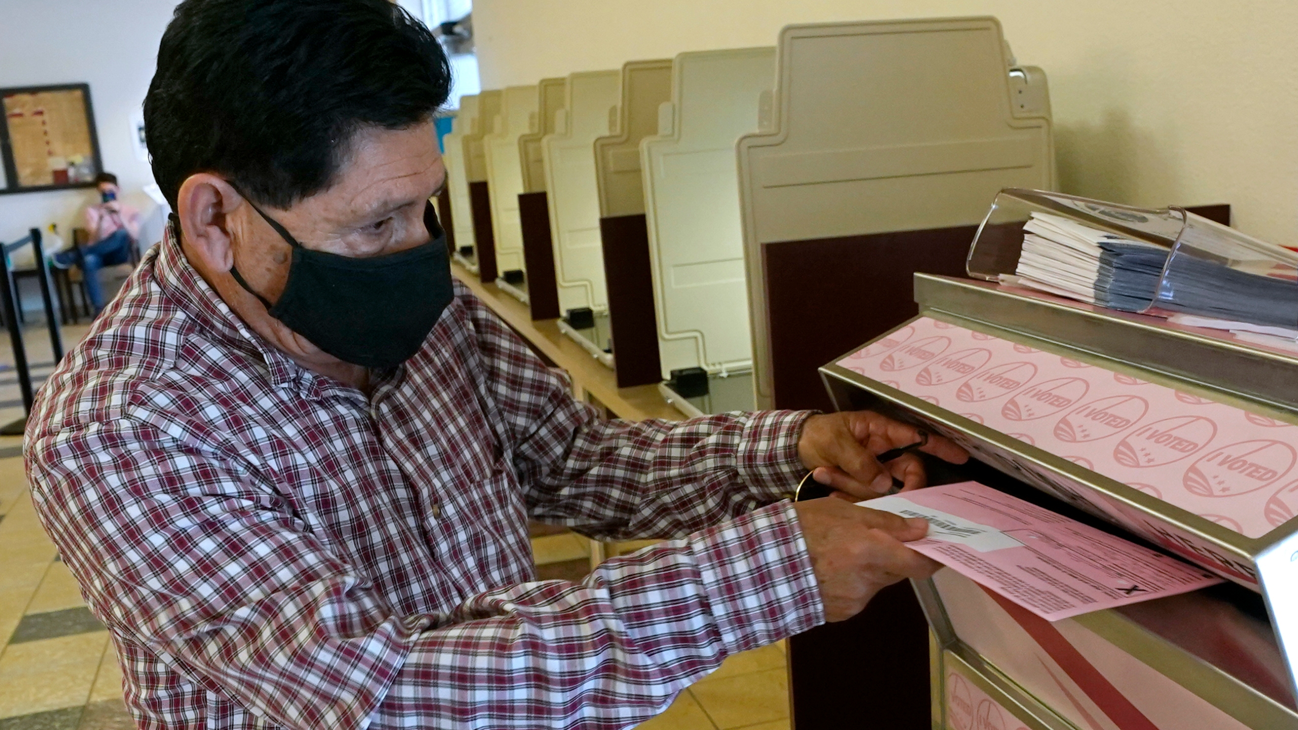 In this Aug. 30, 2021 file photo, Francisco Torres casts his ballot at the Sacramento County Registrar of Voters office in Sacramento, Calif. (AP Photo/Rich Pedroncelli, File)