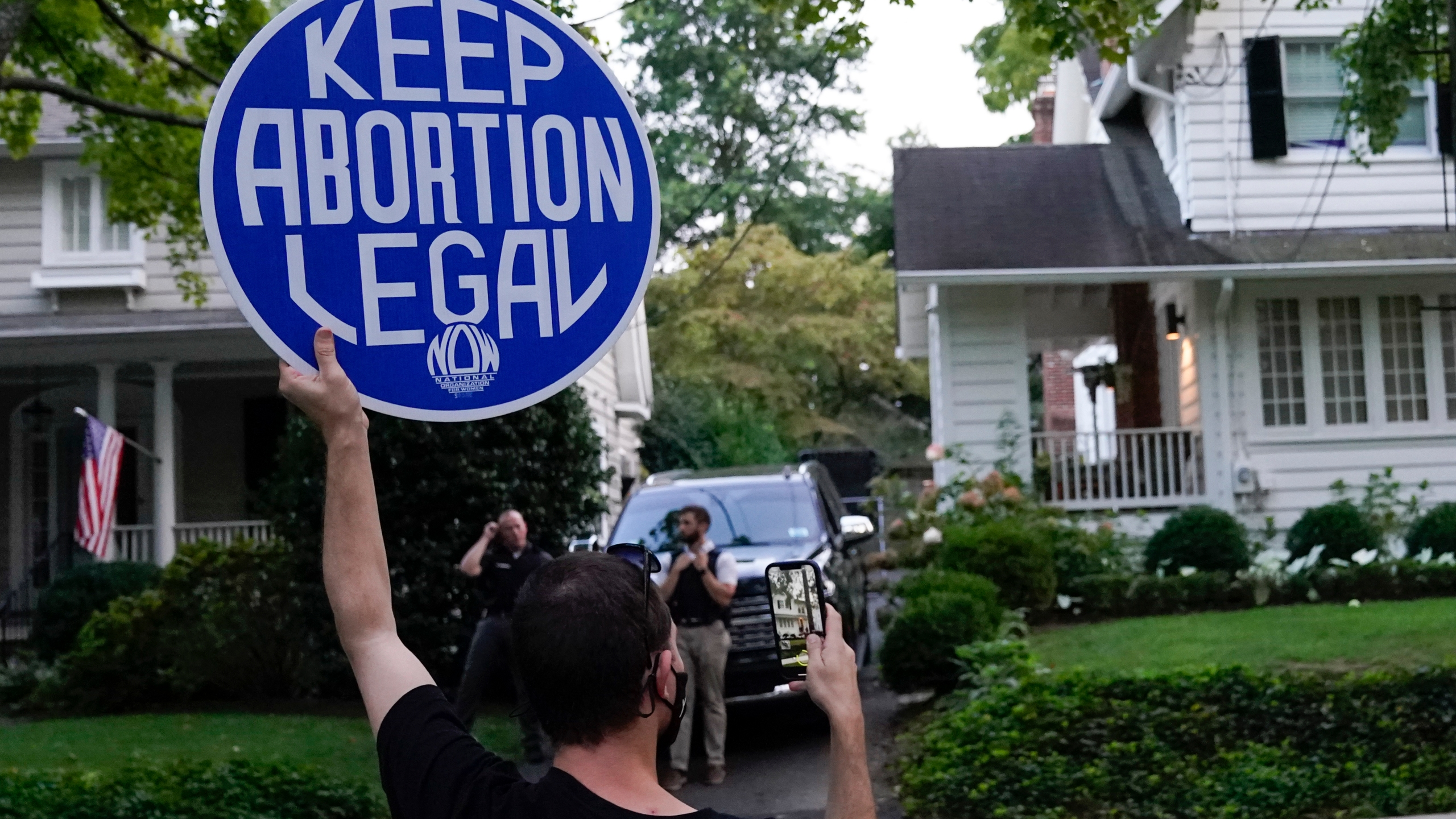 A protester stands outside the home of Supreme Court Justice Brett Kavanaugh, Monday, Sept. 13, 2021, in Chevy Chase, Md.(AP Photo/Patrick Semansky)