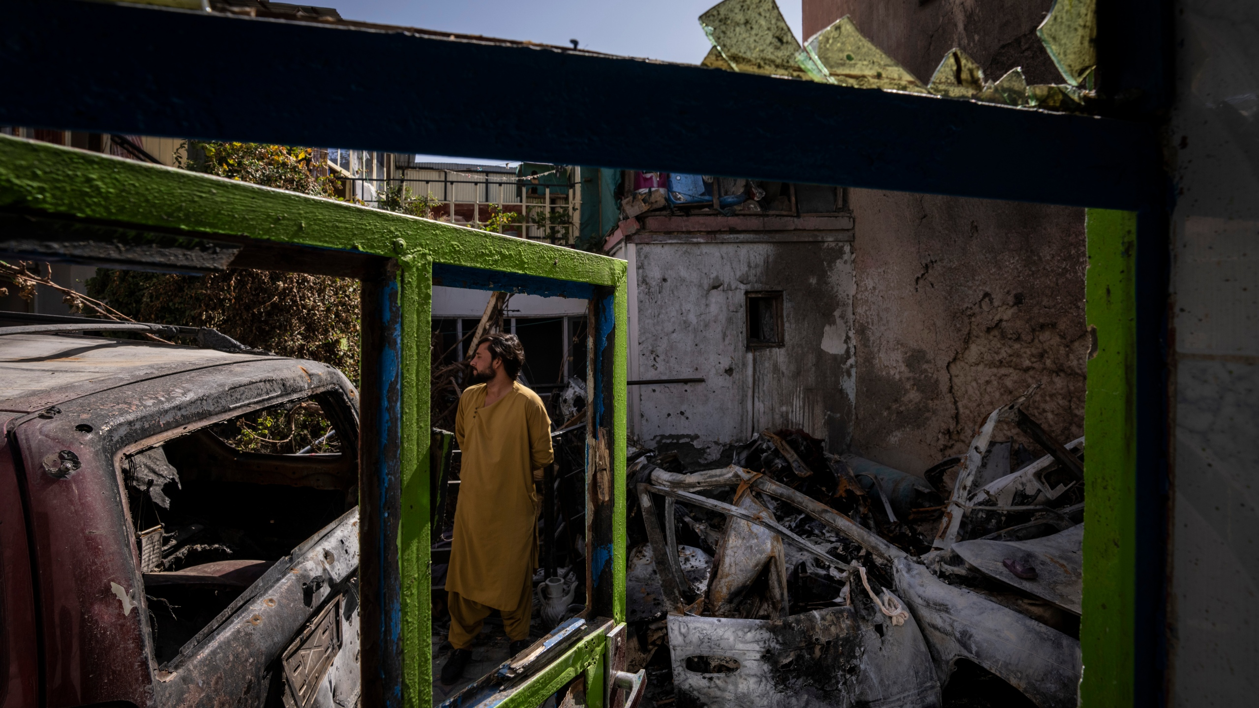 An Afghan inspects the damage of Ahmadi family house in Kabul, Afghanistan, on Sept. 13, 2021. Zemerai Ahmadi, the Afghan man who was killed in a U.S. drone strike last month, was an enthusiastic and beloved longtime employee at an American humanitarian organization, his colleagues say. (Bernat Armangue / Associated Press)