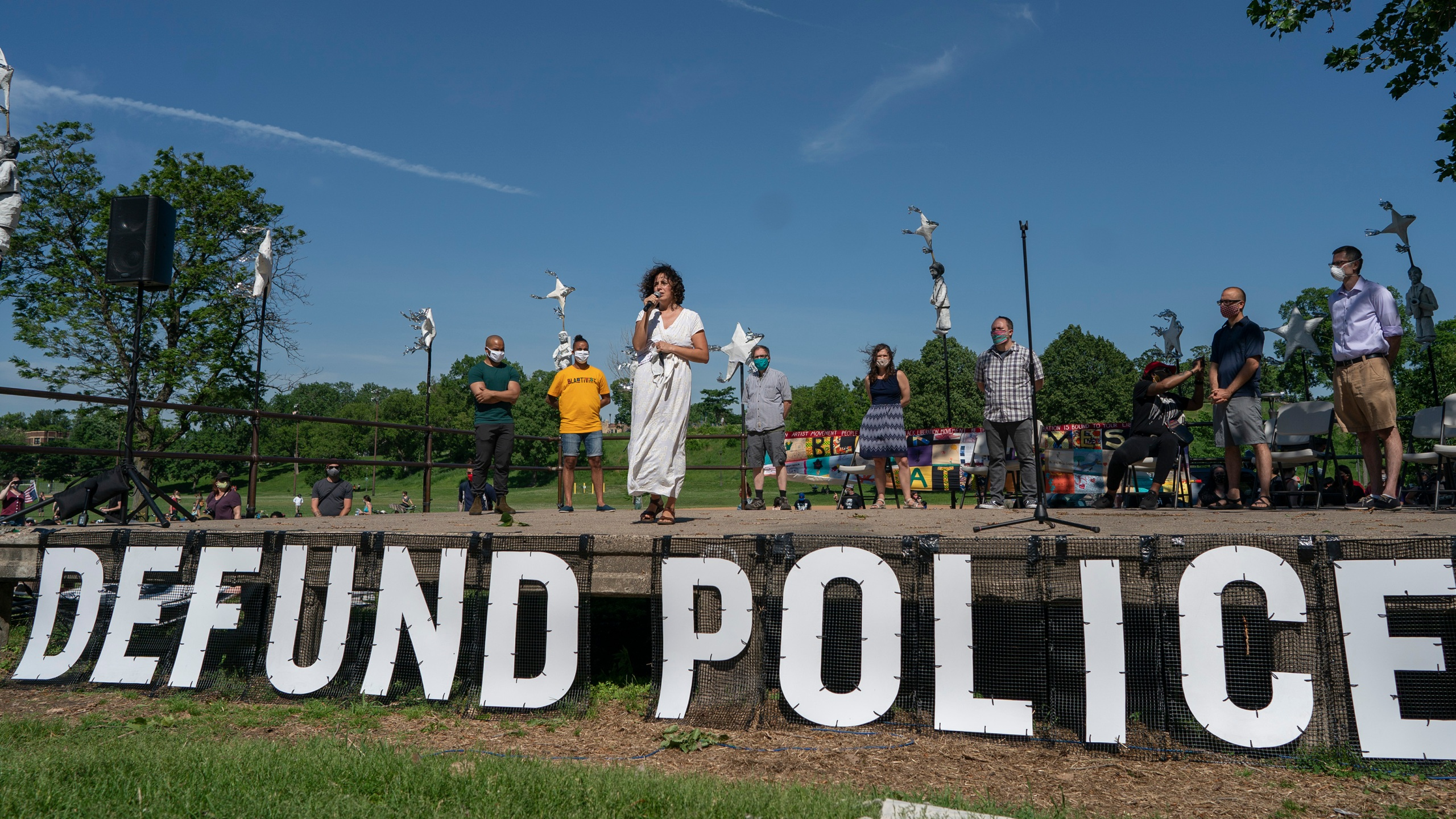 """In this June 7, 2020, file photo, Alondra Cano, a city council member, speaks during """"The Path Forward"""" meeting at Powderhorn Park in Minneapolis, which was organized to talk about the defunding of the Minneapolis Police Department. (Jerry Holt/Star Tribune via Associated Press)"""