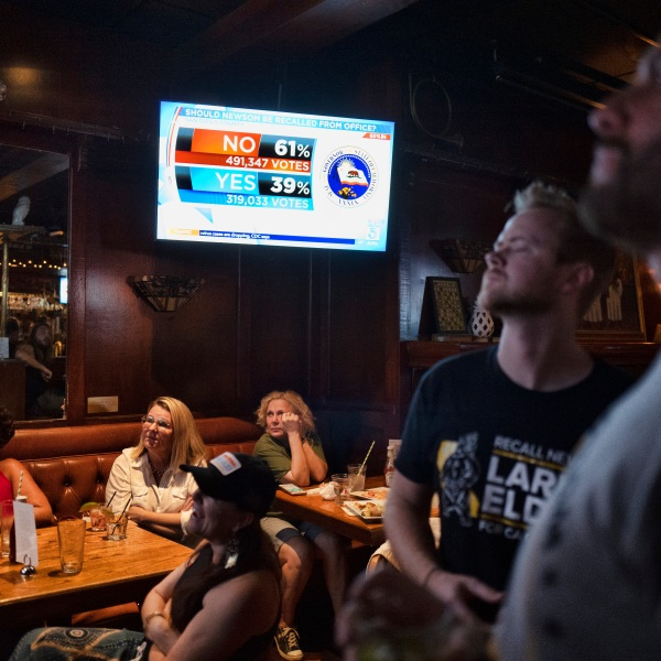 A group of pro-recall voters gather to watch early results of the California recall election during a party at the Pineapple Hill Saloon & Grill in Los Angeles on Sept. 14, 2021. (Richard Vogel / Associated Press)