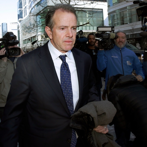 In this March 25, 2019 file photo, Gordon Ernst, former Georgetown tennis coach, departs federal court in Boston after facing charges in a nationwide college admissions bribery scandal. (Steven Senne/Associated Press)