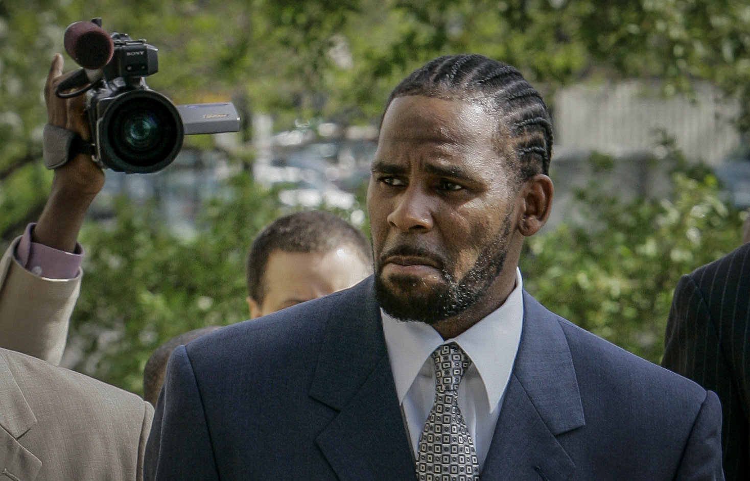 This photo from Friday May 9, 2008, shows R. Kelly arriving for the first day of jury selection in his child pornography trial at the Cook County Criminal Courthouse in Chicago. (Charles Rex Arbogast/Associated Press)
