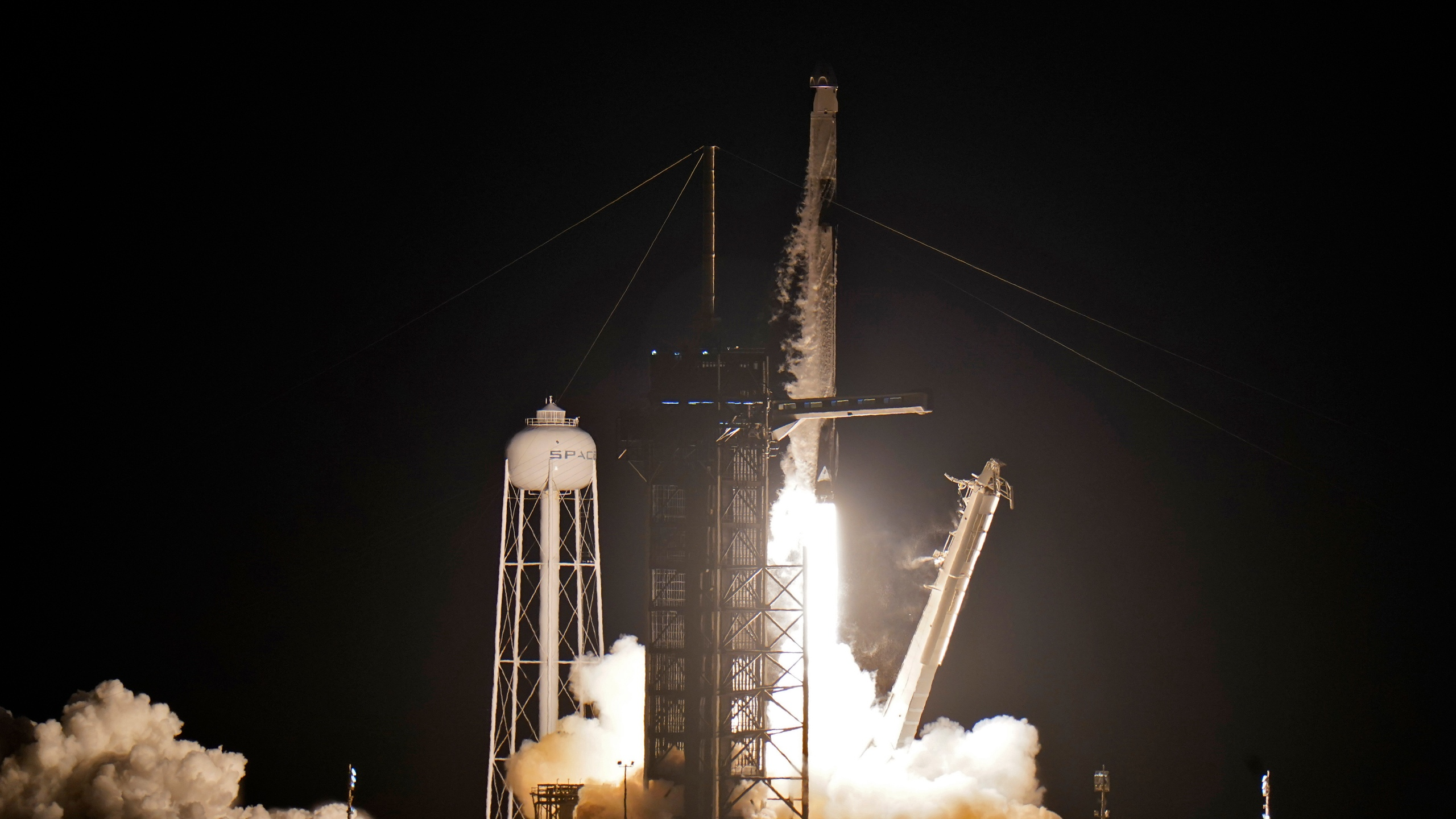 A SpaceX Falcon 9, with four private citizens onboard, lifts off from Kennedy Space Center's Launch Pad 39-A in Cape Canaveral , Fla., on Sept. 15, 2021. (Chris O'Meara / Associated Press)