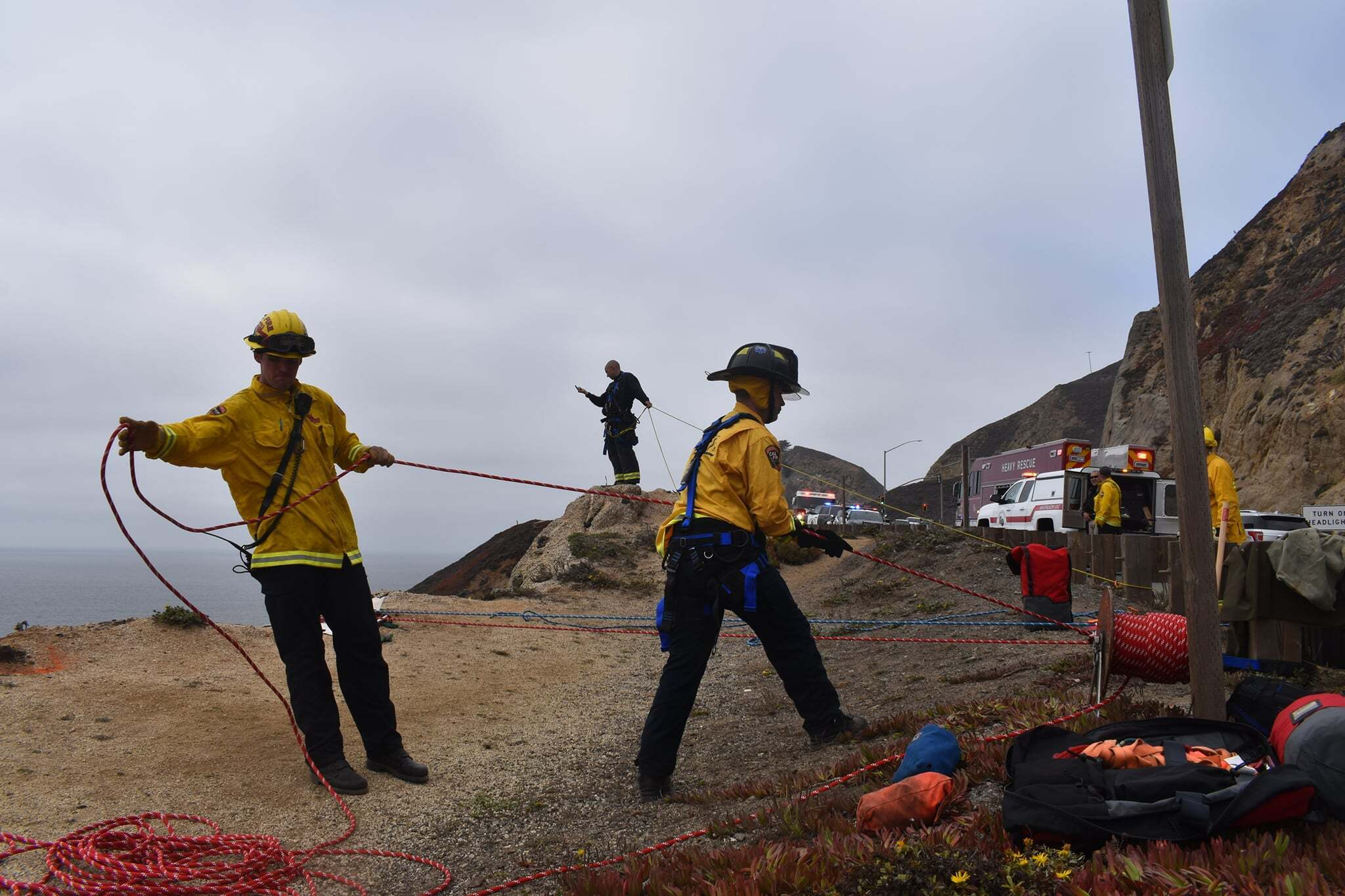 In this photo provided by Cal Fire San Mateo, Santa Cruz Unit firefighters recover a vehicle that plunged off a cliffside road killing a man south of San Francisco on Sept. 15, 2021. (CAL FIRE San Mateo - Santa Cruz Unit via Associated Press)
