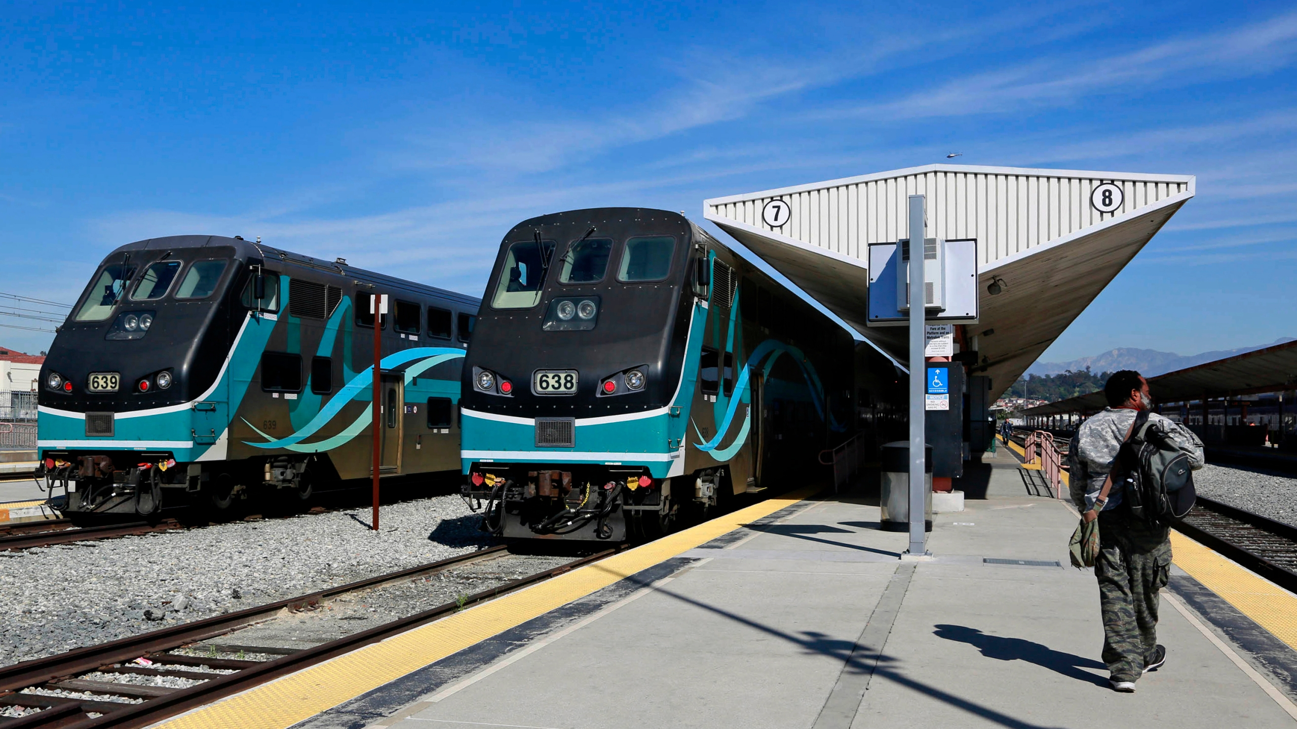 In this Feb. 25, 2015, file photo, Metrolink commuter trains stand at a platform at Union Station in downtown Los Angeles. (AP Photo/Nick Ut, File)