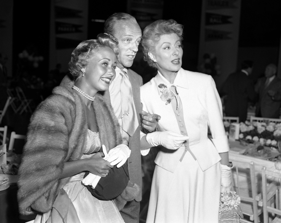 Jane Powell, left, Fred Astaire, center, and Greer Garson pose for a photo in Los Angeles on Sept. 9, 1953. (Ellis Bosworth / Associated Press)