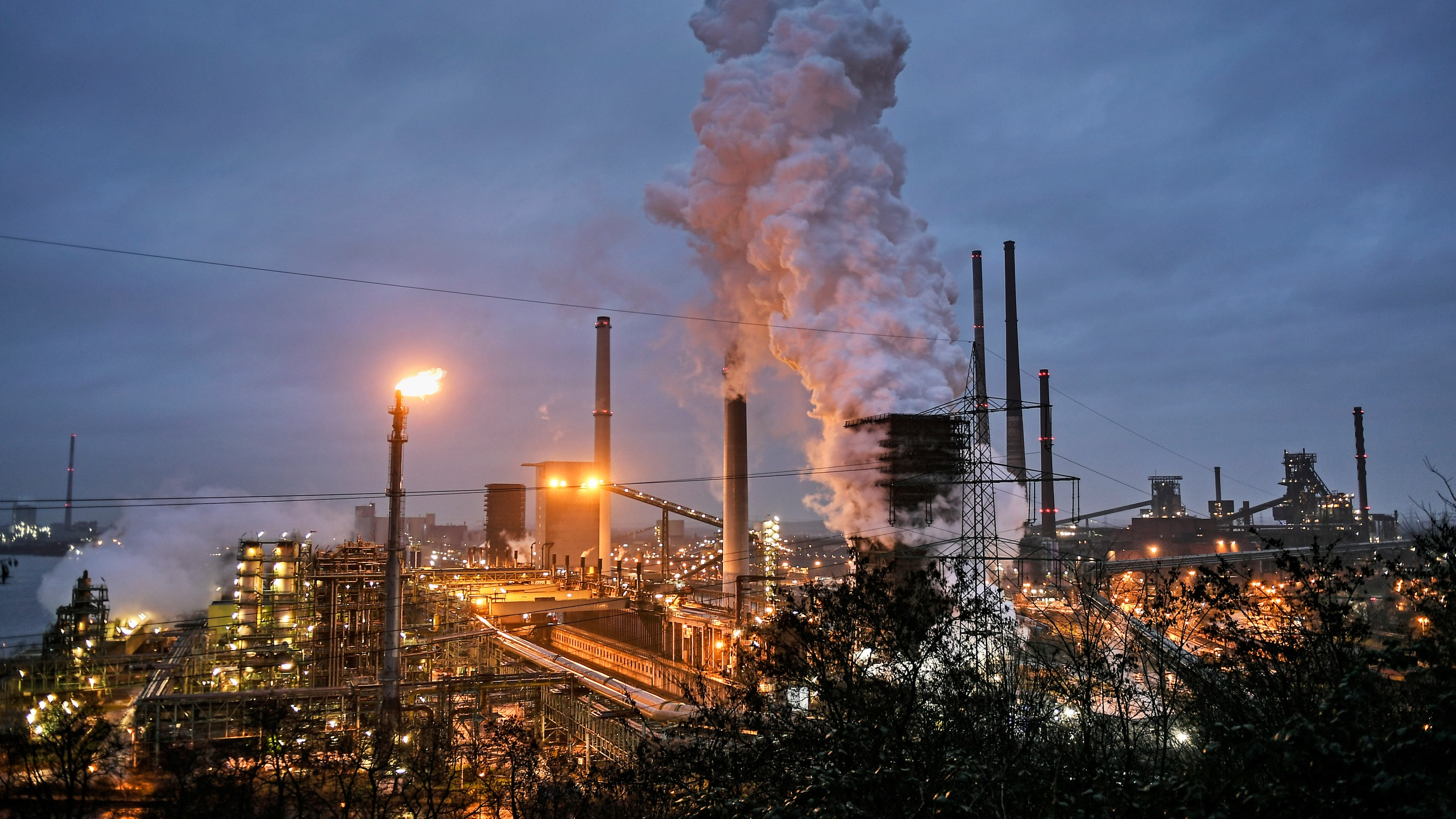 A ThyssenKrupp coking plant steams around the clock for the nearby steel mill in Duisburg, Germany, on Jan. 30, 2020. (Martin Meissner / Associated Press)