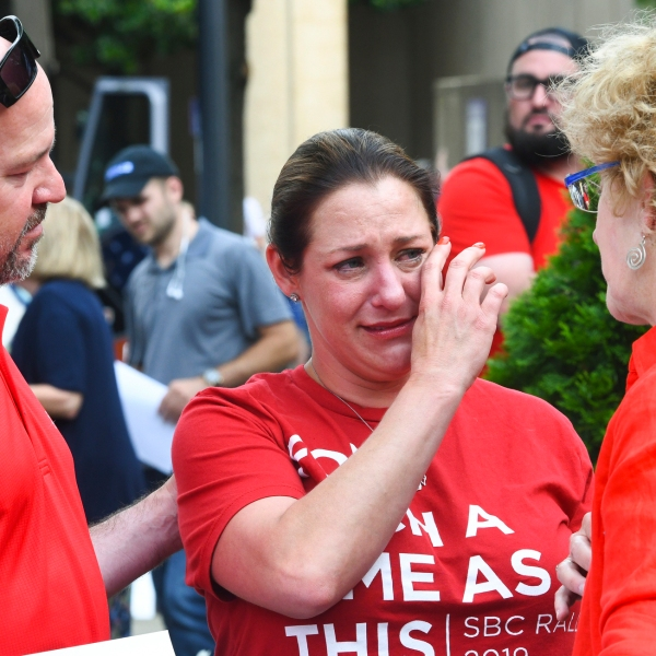 In this Tuesday, June 11, 2019 file photo, Jules Woodson, center, of Colorado Springs, Colo., is comforted by her boyfriend Ben Smith, left, and Christa Brown while demonstrating outside the Southern Baptist Convention's annual meeting in Birmingham, Ala. (AP Photo/Julie Bennett, File)