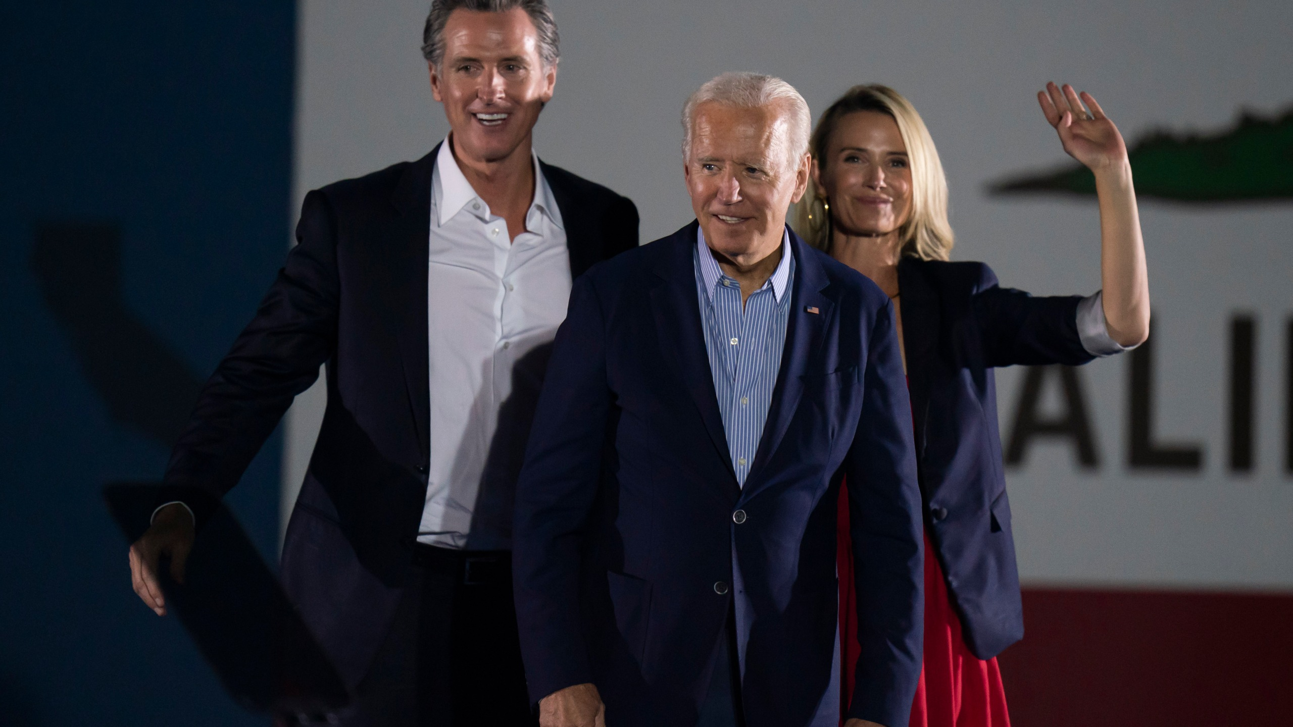 In this Sept. 13, 2021, file photo President Joe Biden, center, smiles to the crowd as he is flanked by California Gov. Gavin Newsom and Jennifer Siebel Newsom at a rally ahead of the California gubernatorial recall election in Long Beach, Calif. (AP Photo/Jae C. Hong, File)