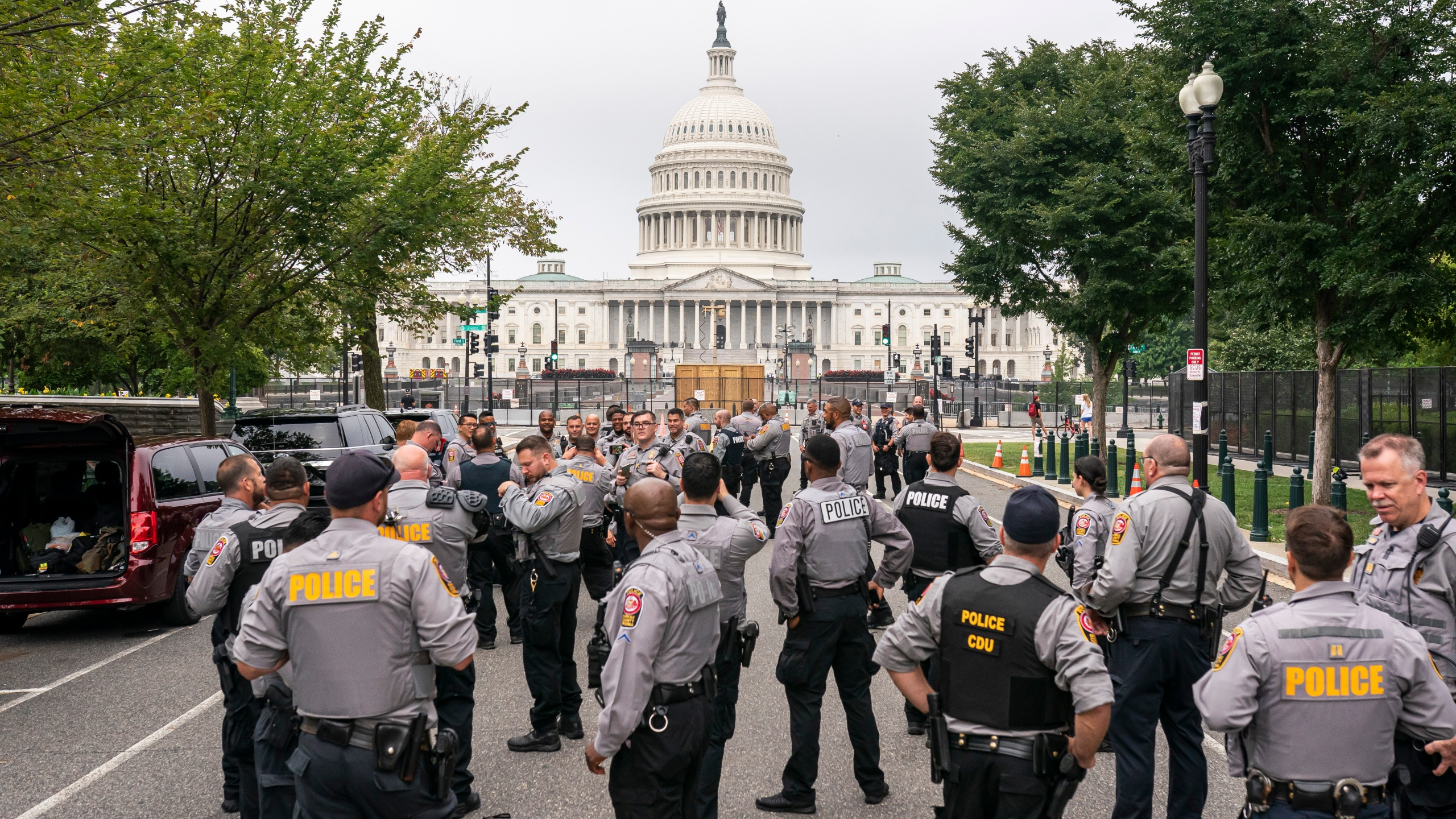Police stage at a security fence ahead of a rally near the U.S. Capitol in Washington, Saturday, Sept. 18, 2021. (AP Photo/Nathan Howard)