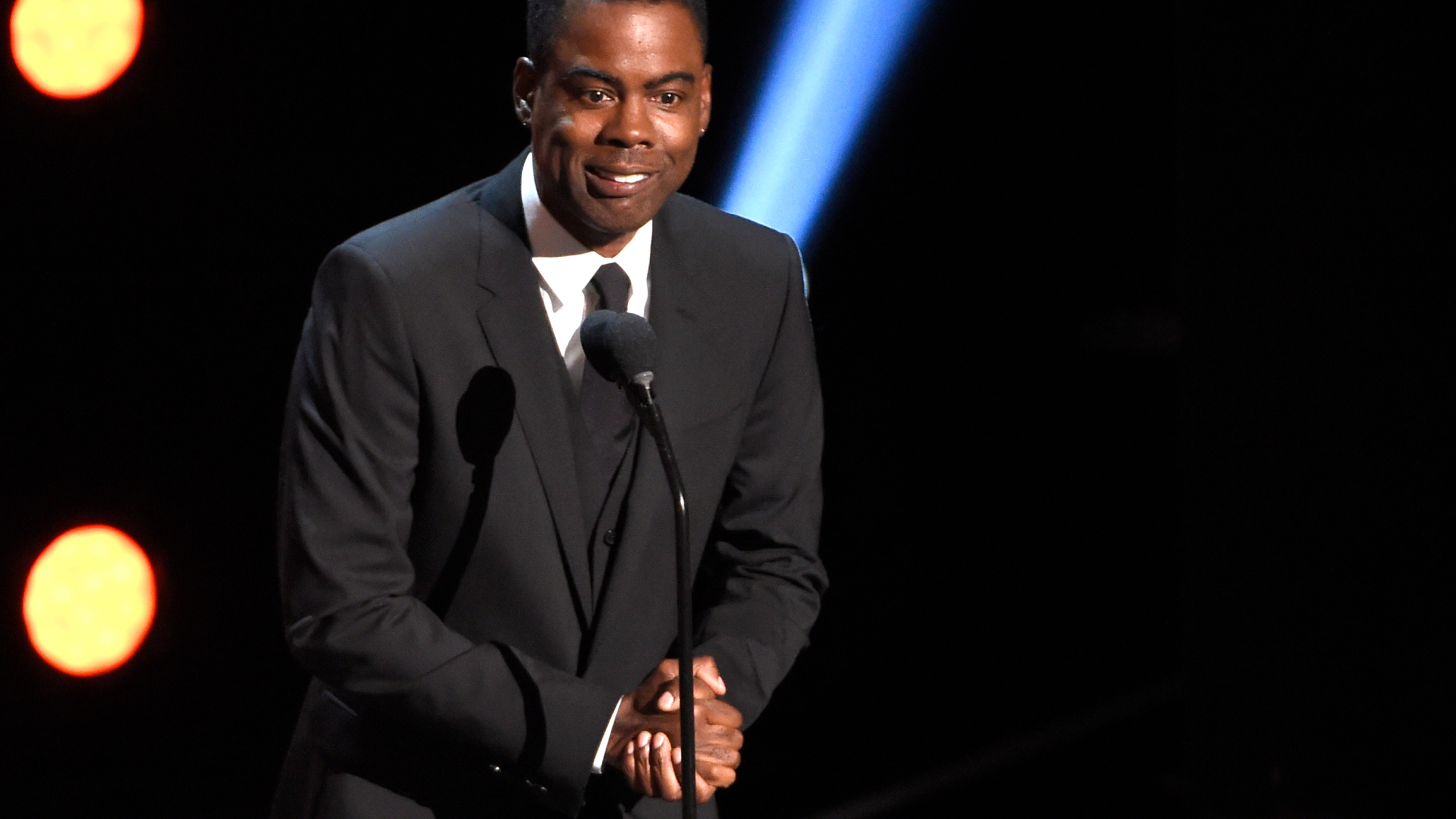In this March 30, 2019 file photo, Chris Rock presents the award for outstanding comedy series at the 50th annual NAACP Image Awards at the Dolby Theatre in Los Angeles. (Chris Pizzello/Invision/AP, File)