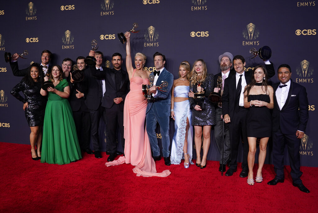 """Brett Goldstein, Hannah Waddingham, Jason Sudeikis, Juno Temple and the cast and crew from """"Ted Lasso"""" pose with their awards at the 73rd Primetime Emmy Awards on Sunday, Sept. 19, 2021, at L.A. Live. (AP Photo/Chris Pizzello)"""