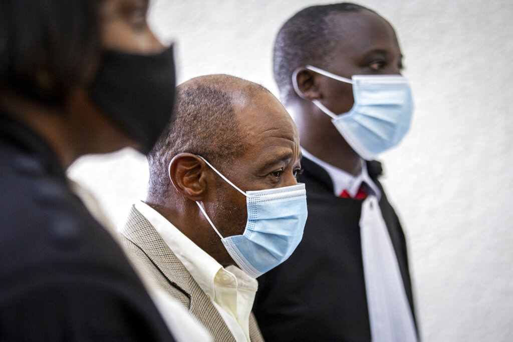 """In this Monday, Sept. 14, 2020 file photo, Paul Rusesabagina, center, whose story inspired the film """"Hotel Rwanda"""" for saving people from genocide, appears at the Kicukiro Primary Court in the capital Kigali, Rwanda. (AP Photo, File)"""