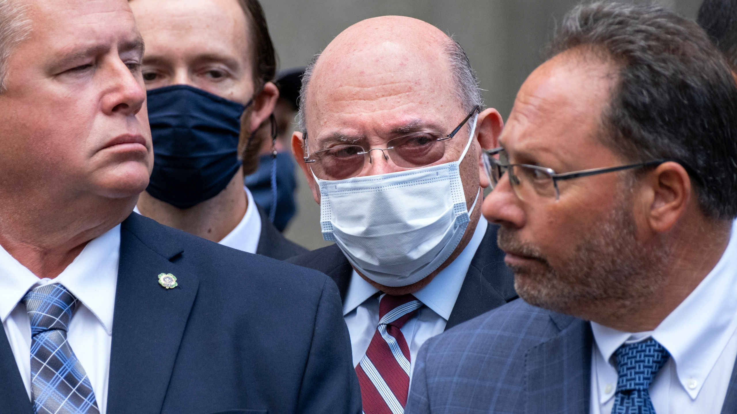 """The Trump Organization's Chief Financial Officer Allen Weisselberg, center, awaits a car after leaving a courtroom appearance in New York, Monday, Sept. 20, 2021. Donald Trump's company and its longtime finance chief were charged Thursday in what a prosecutor called a """"sweeping and audacious"""" tax fraud scheme that saw the Trump executive allegedly receive more than $1.7 million in off-the-books compensation, including apartment rent, car payments and school tuition. (AP Photo/Craig Ruttle)"""
