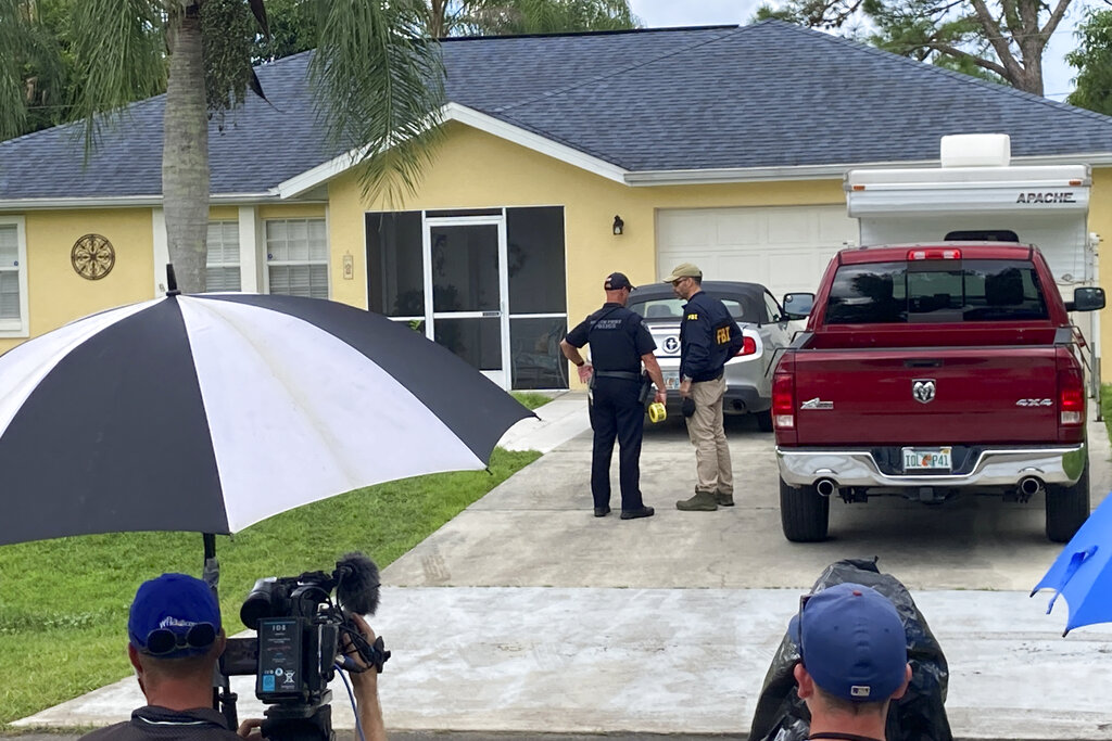 Law enforcement officials investigate home of a young man wanted for questioning in the disappearance of his girlfriend, Gabby Petito, on Monday, Sept. 20, 2021 in North Port, Fla. (AP Photo/Curt Anderson)