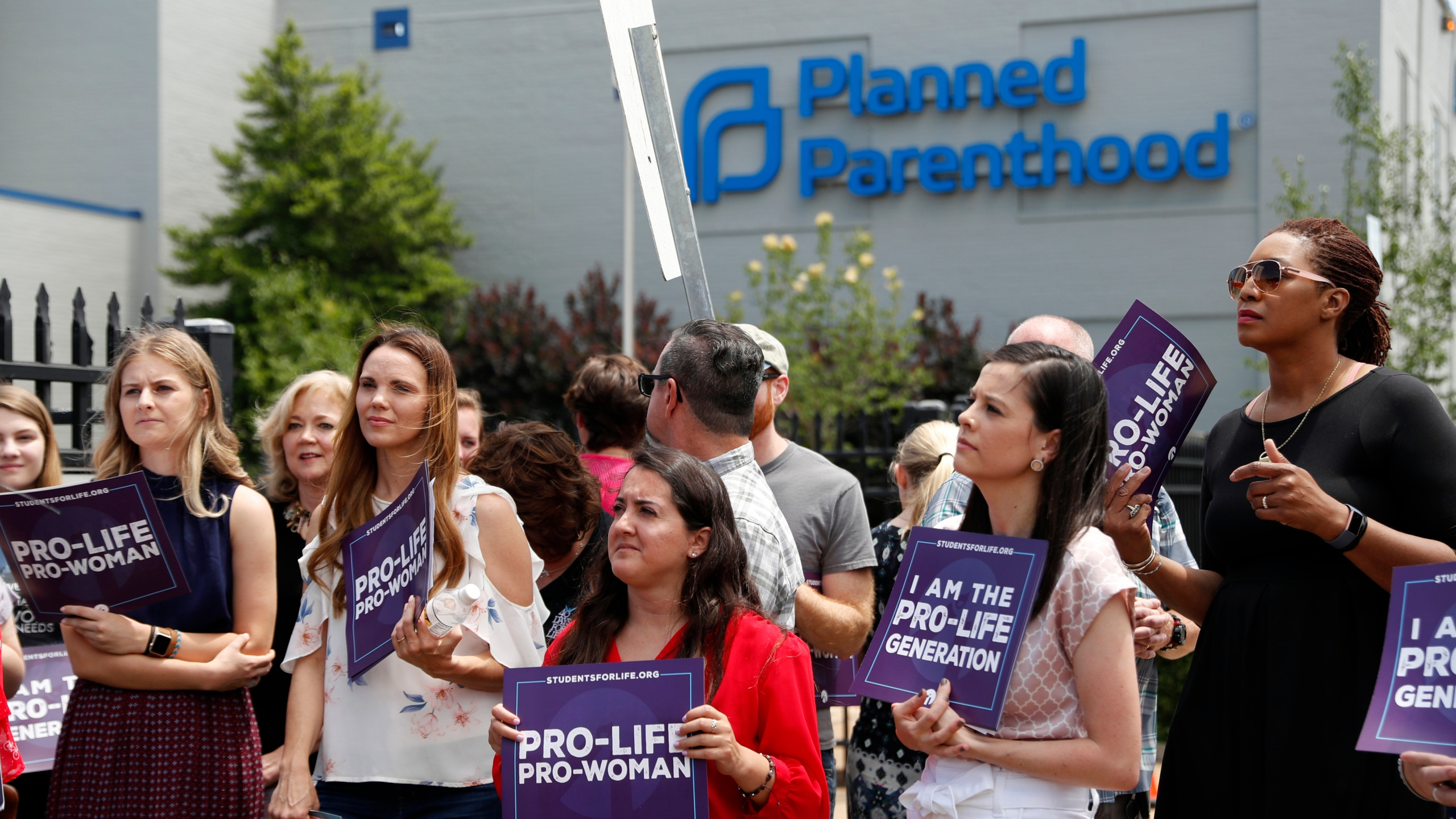 In this June 4, 2019, file photo, anti-abortion advocates gather outside the Planned Parenthood clinic in St. Louis. A federal appeals court on Tuesday, Sept. 21, 2021, will consider whether Missouri can implement a sweeping law aimed at limiting abortions. The law adopted in 2019 would ban abortions at or around the eighth week of pregnancy. It also would prohibit abortions based on a Down syndrome diagnosis. (AP Photo/Jeff Roberson, File)