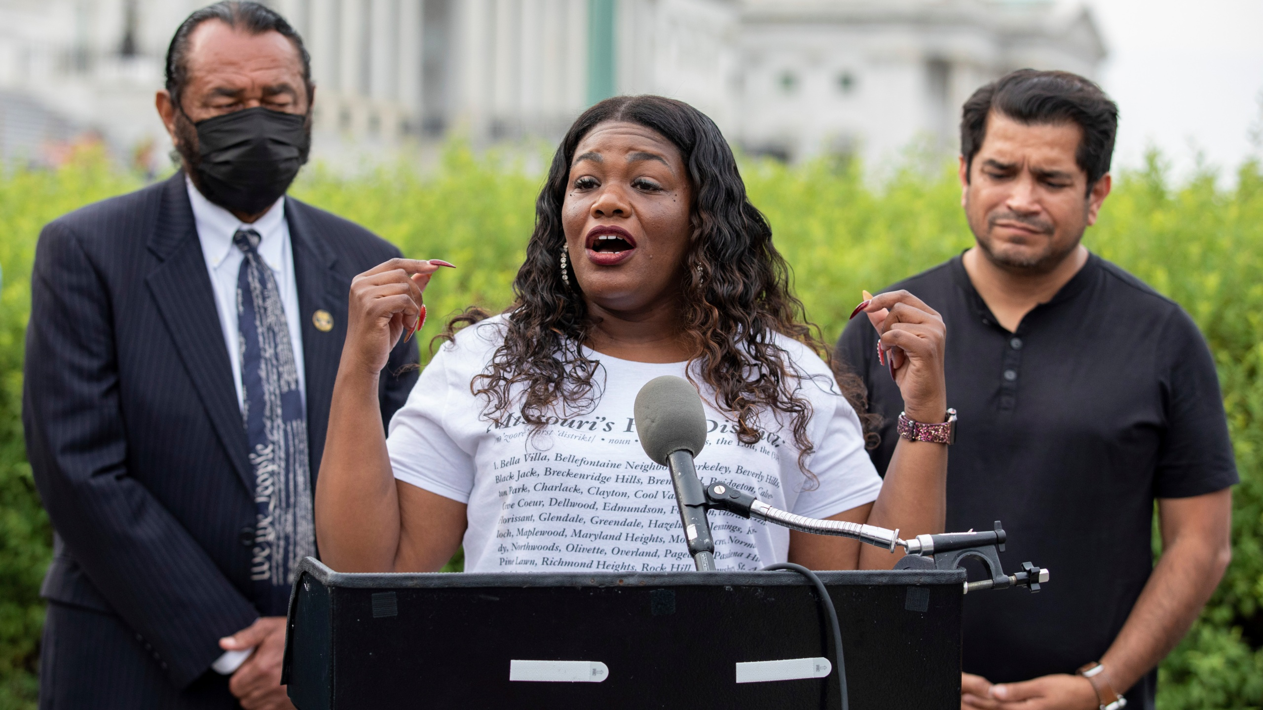 In this Aug. 3, 2021, file photo Rep. Cori Bush, D-Mo., flanked by Rep. Al Green, D-Texas, left, and Rep. Jimmy Gomez, D-Calif., right, speaks to the press after it was announced that the Biden administration will enact a targeted nationwide eviction moratorium outside of Capitol Hill in Washington. Several progressive lawmakers, including Bush, on Tuesday, Sept. 21, introduced a bill that would reimpose a nationwide eviction moratorium at a time when deaths from COVID-19 are running at their highest levels since early March. (AP Photo/Amanda Andrade-Rhoades, File)
